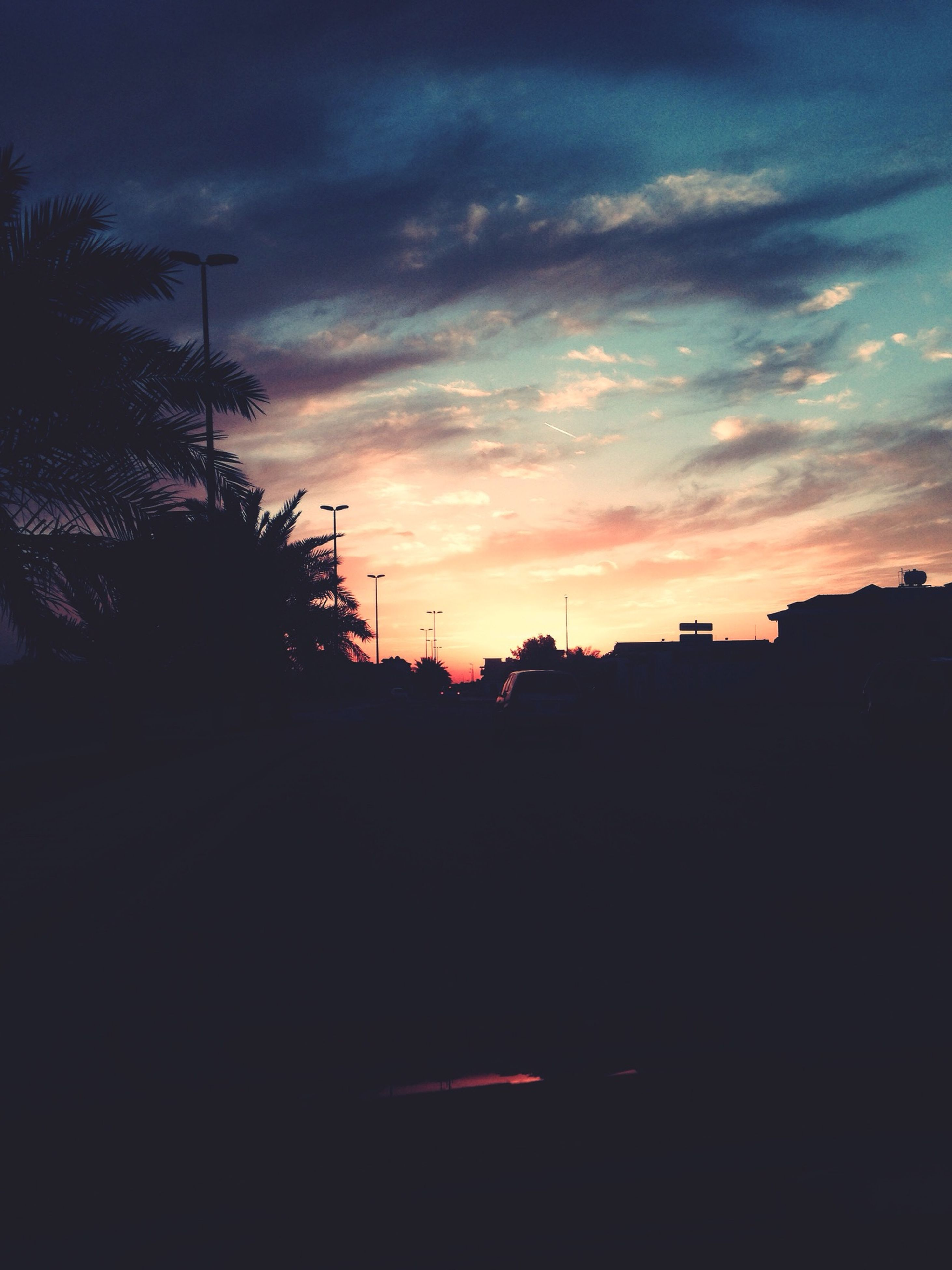 sunset, silhouette, sky, building exterior, architecture, built structure, cloud - sky, orange color, tree, cloud, dark, city, house, dusk, beauty in nature, scenics, cloudy, residential structure, dramatic sky, nature