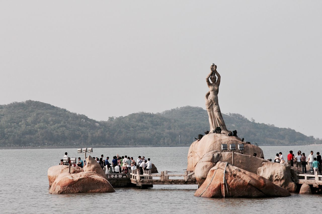 Fisher Girl Statue Large Group Of People Day Outdoors Sea Clear Sky Zhuhai Rocks Rocks In The Sea Lovers Road - Zhuhai Visitors Coastal Views Fisher Girl