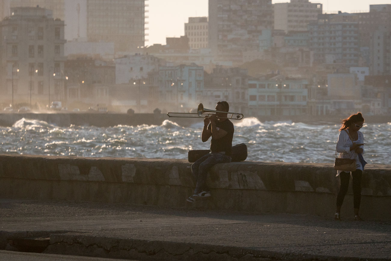 Malecon, November 2016 Before Sunset Coastline Adult Architecture Building Exterior Built Structure City Day Evening Full Length Leisure Activity Lifestyles Malecón, La Habana Men Musician Nature Outdoors People Real People Sea Splashing Waves Trombone Trombonist Two People Water