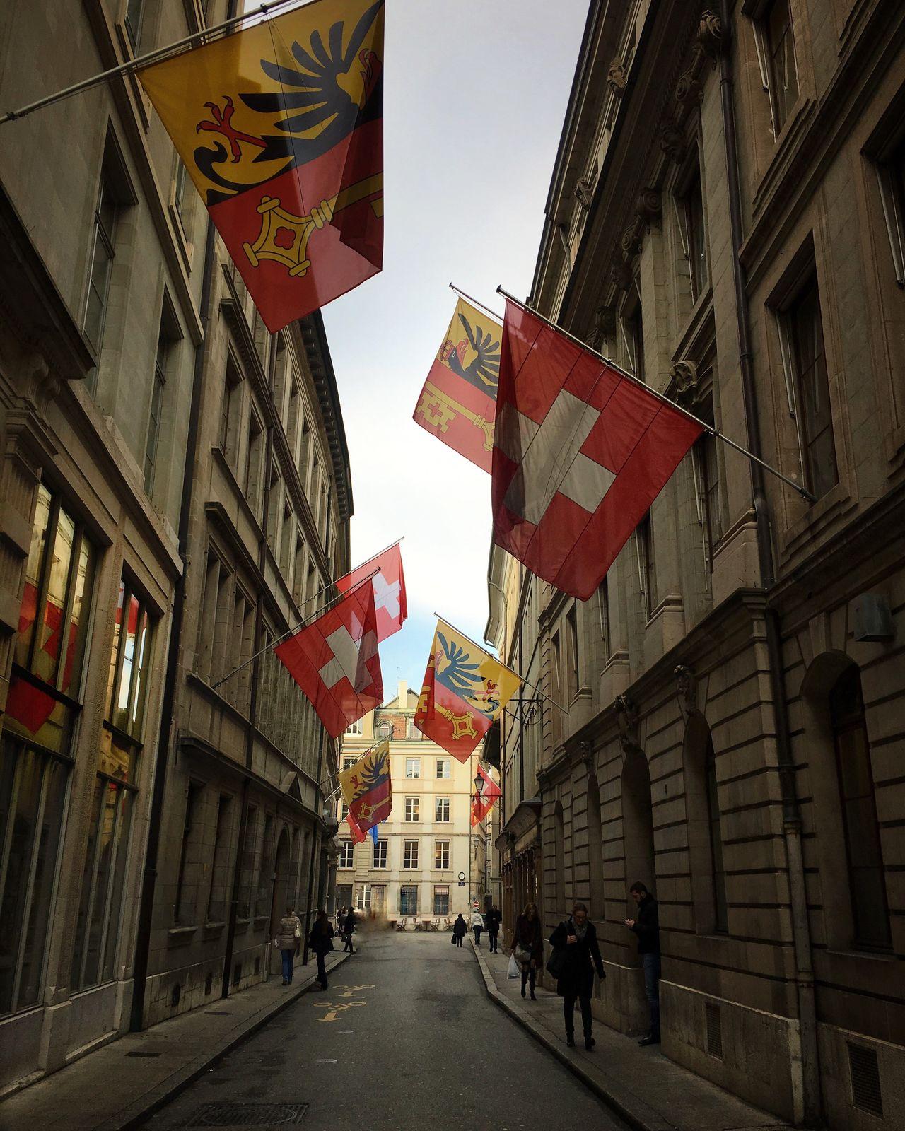 Geneva Geneve Switzerland Switzerlandpictures Swiss National Pride NationalPride Europe Flag Architecture Street Patriotism Cobblestone Streetphotography City