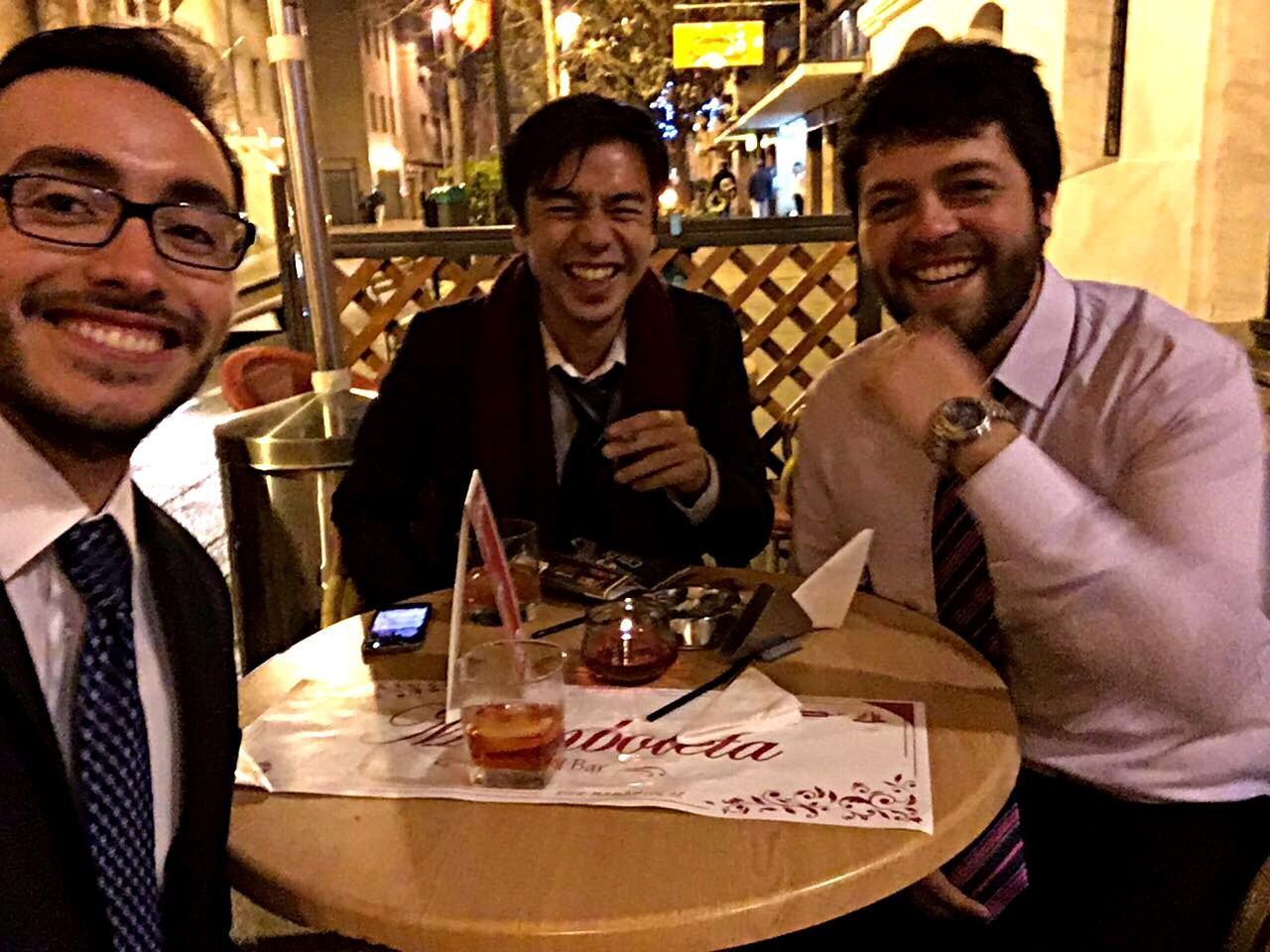 smiling, well-dressed, men, mid adult, mid adult men, food and drink, bar - drink establishment, portrait, table, friendship, indoors, cheerful, happy hour, sitting, nightlife, happiness, togetherness, looking at camera, businessman, suit, standing, business, adults only, people, adult, only men, day