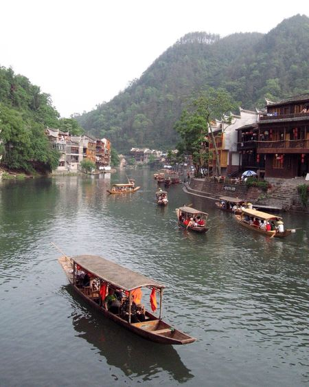 Fenghuang, Hunan, China | FengHuang Hunan Hunan Province, China Shangri-La Ancient Town China Beauty China Hanging Out Beauty In Nature Tranquility Water Water Reflections Tuo River Ancient Architecture Tranquil Scene Outdoors