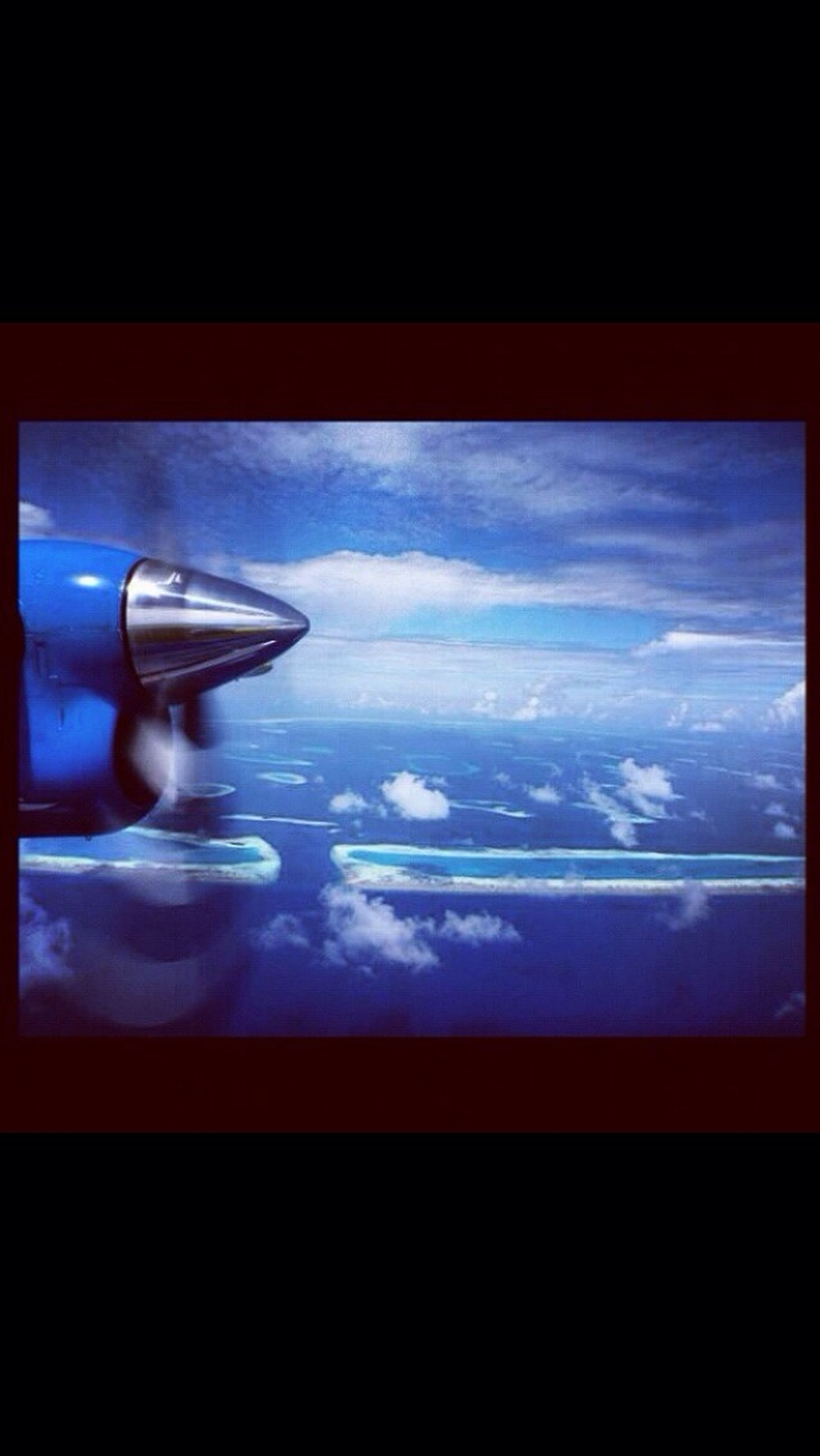 window, indoors, glass - material, transparent, sky, water, transportation, reflection, mode of transport, vehicle interior, looking through window, silhouette, cloud - sky, sea, glass, airplane, auto post production filter, blue, cloud, nature
