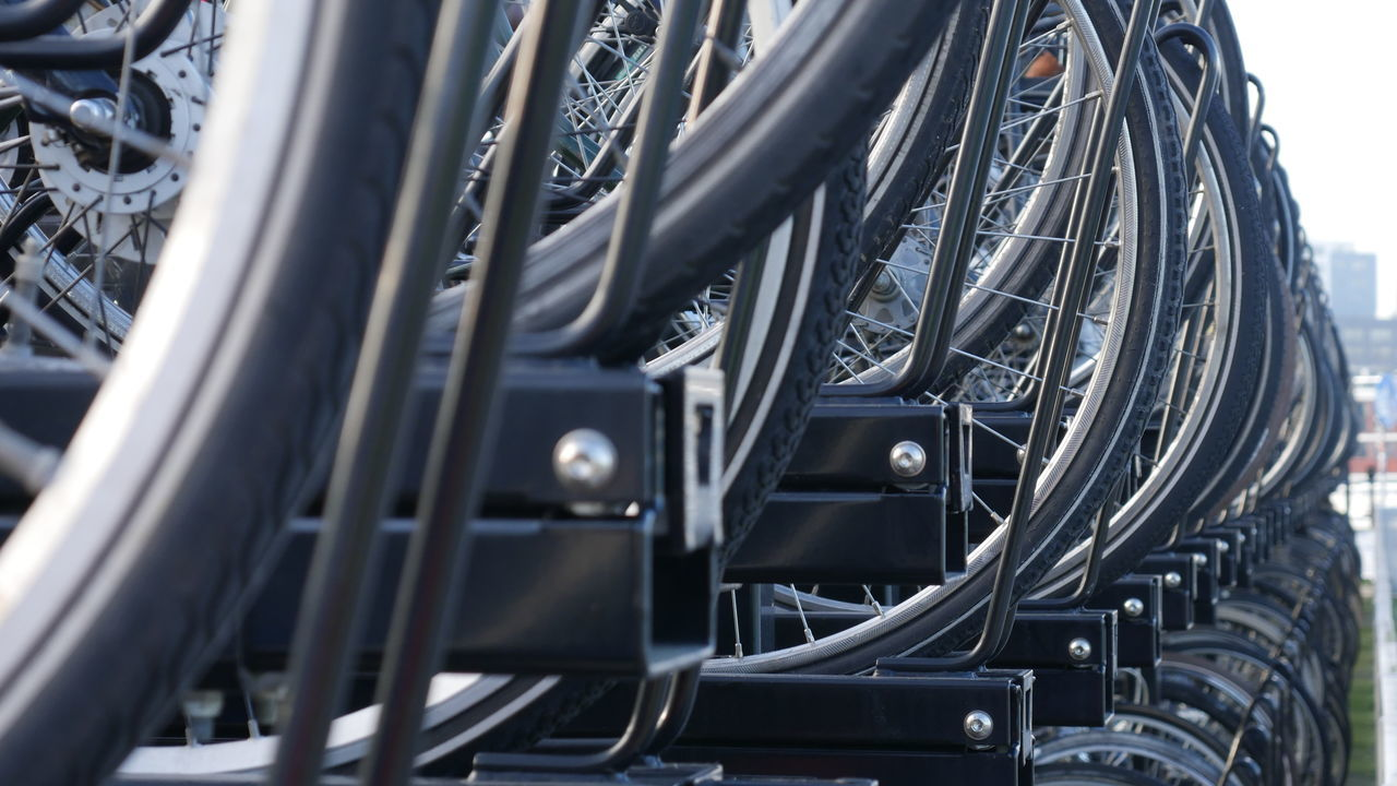 Low Angle View Of Bicycles Parked At Street