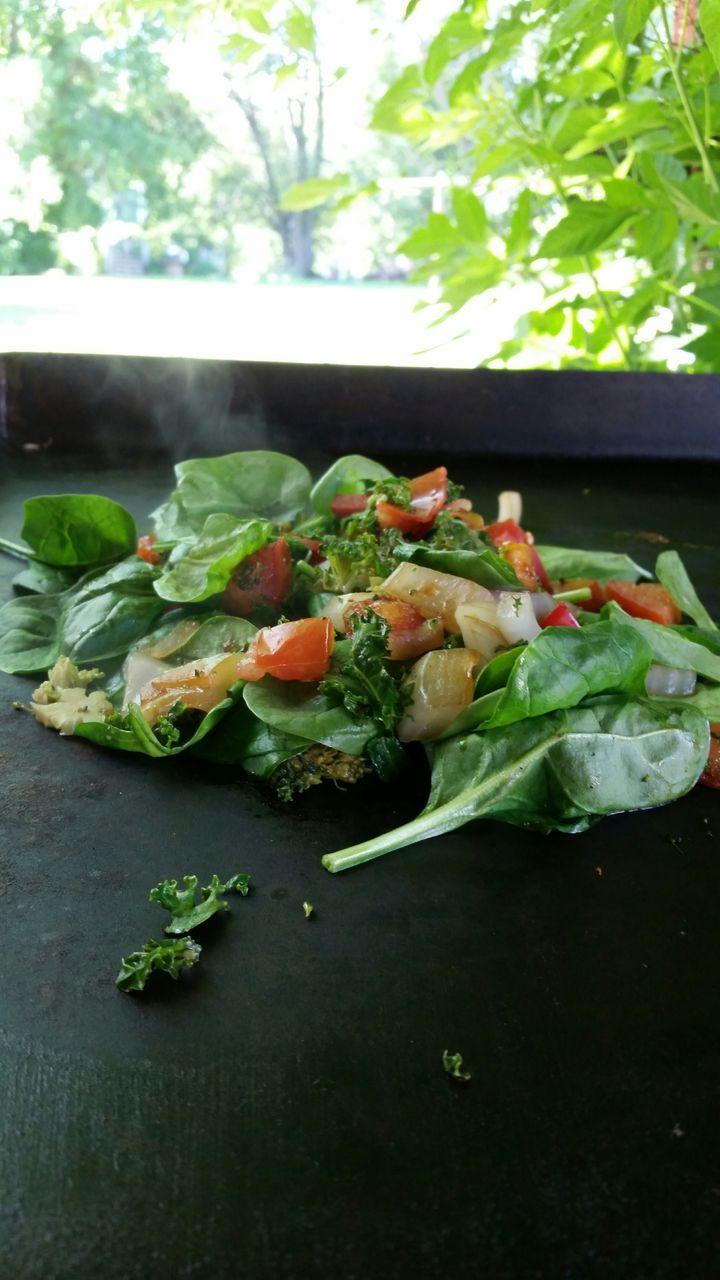 Close-Up Of Preparing Food On Griddle