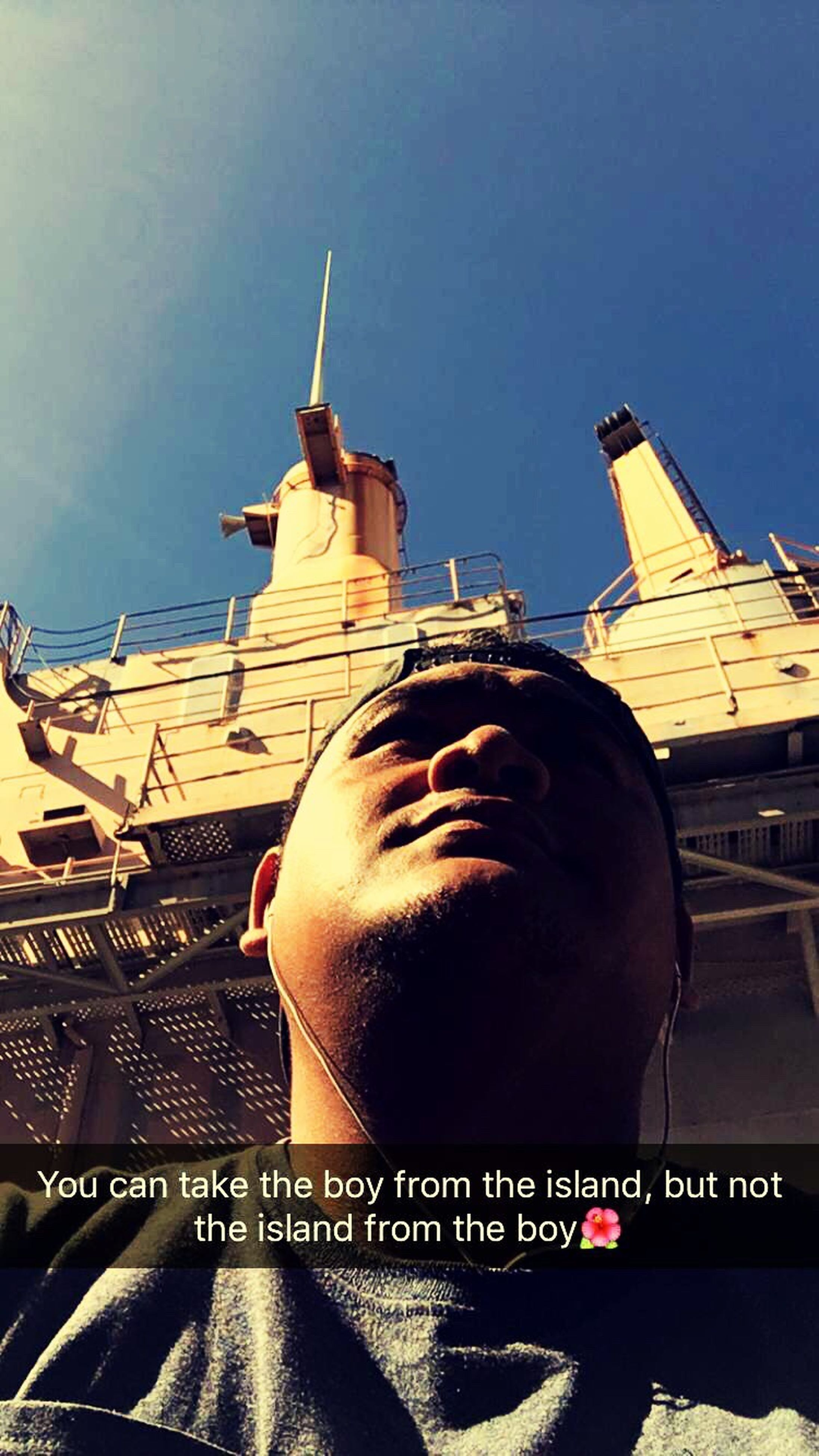 architecture, built structure, building exterior, low angle view, clear sky, lifestyles, young adult, leisure activity, city, sunlight, sky, blue, young men, communication, outdoors, day, standing, men