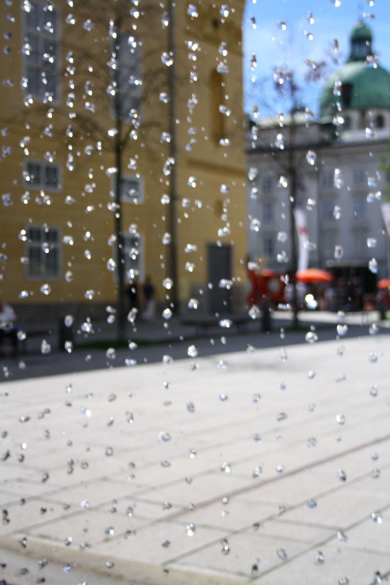 EyeEmNewHere Weather Drop Rain Wet Street RainDrop Fontaine Water No People Drops