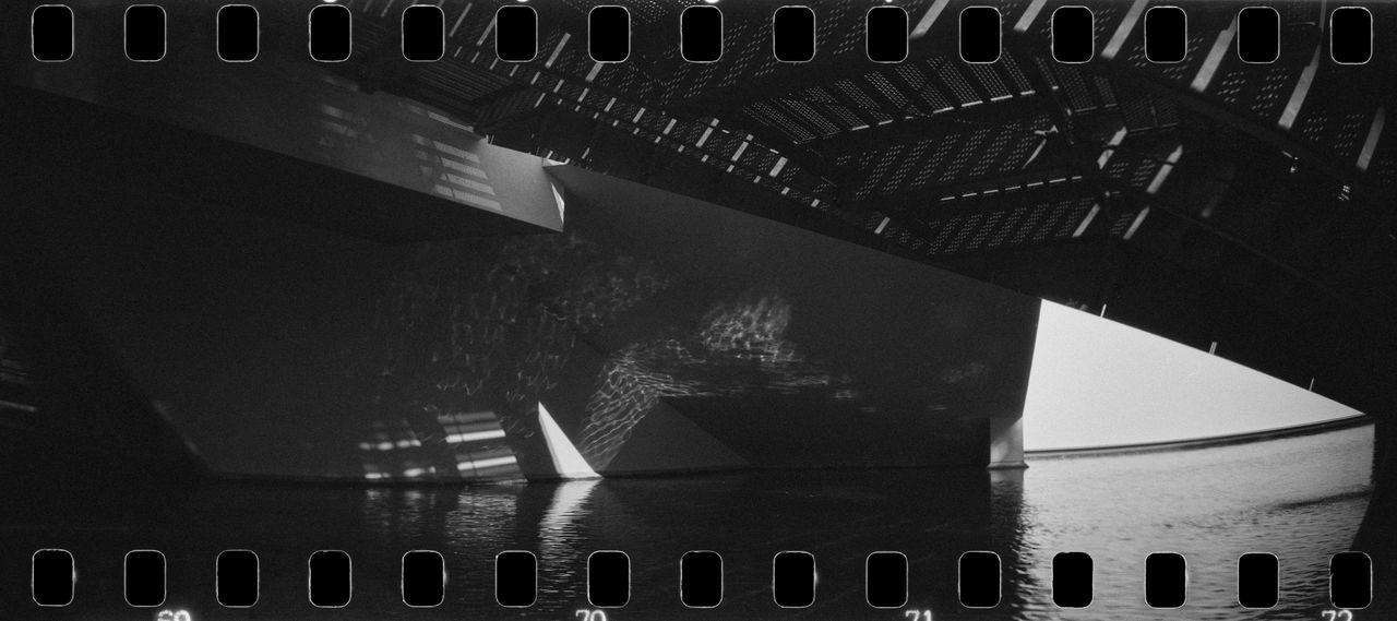 Urban Shapes 35mm 35mm Film Analog Architecture Black & White Blackandwhite Building Film Fomapan400 Light Lomography Modern Modern Architecture Panorama Reflection Rodinal Shadow Side Sprocket Sprocket Rocket Panorama Stairs Theater Urban Water