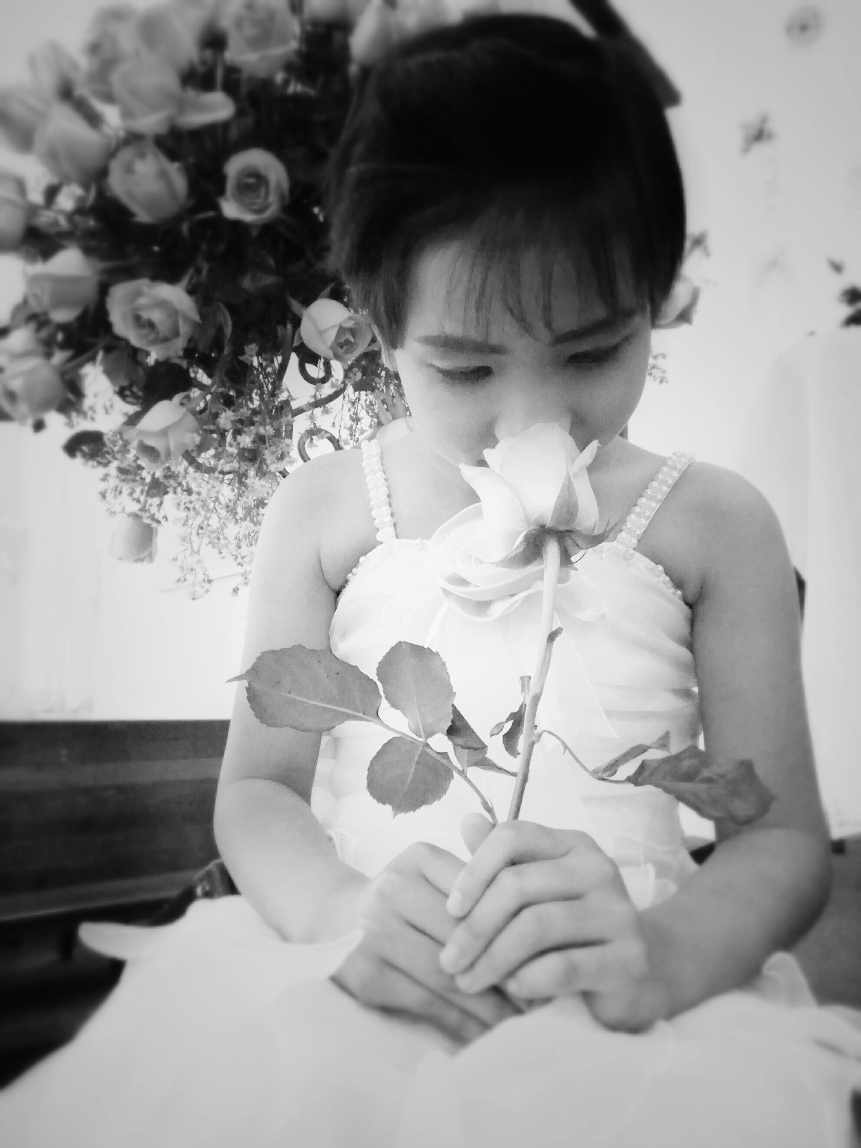 childhood, one person, bangs, child, girls, indoors, looking down, flower, real people, happiness, children only, people, day