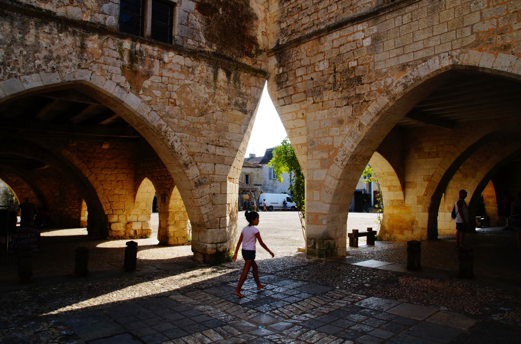Monpazier. France . Old Town Shadows & Lights Square Sunlight Arcade Day Girl Old Buildings Shadow Stone Material Street Photography Streetphotography Walking The Week On EyeEm Your Ticket To Europe