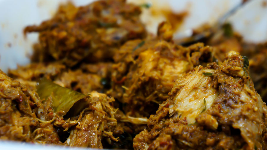 "Rendang is traditionally prepared by the Malay community during festive occasions such as traditional ceremonies, wedding feasts and Hari Raya (Eid al-Fitr).Image of ""Rendang"" in a closeup View. Close-up Food Food And Drink Freshness Indoors  No People Ready-to-eat Rendang Rendangdaging"