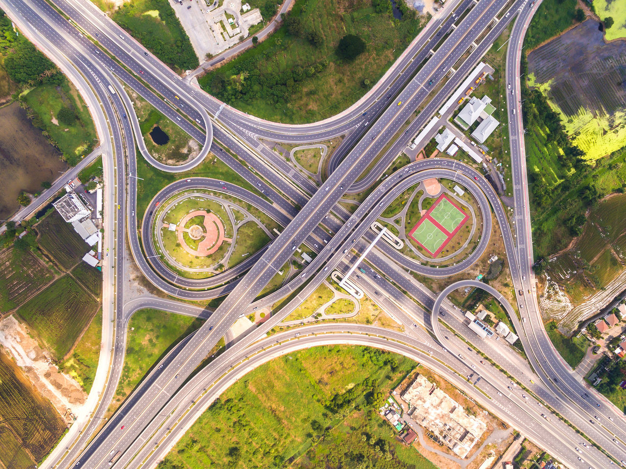Aerial View Architecture Car City City Life Connection Curve Day Elevated Road Flying Flying High Futuristic High Angle View High Up Highway Mode Of Transport Multiple Lane Highway Outdoors Overpass Road Road Intersection Traffic Transportation Travel Two Lane Highway