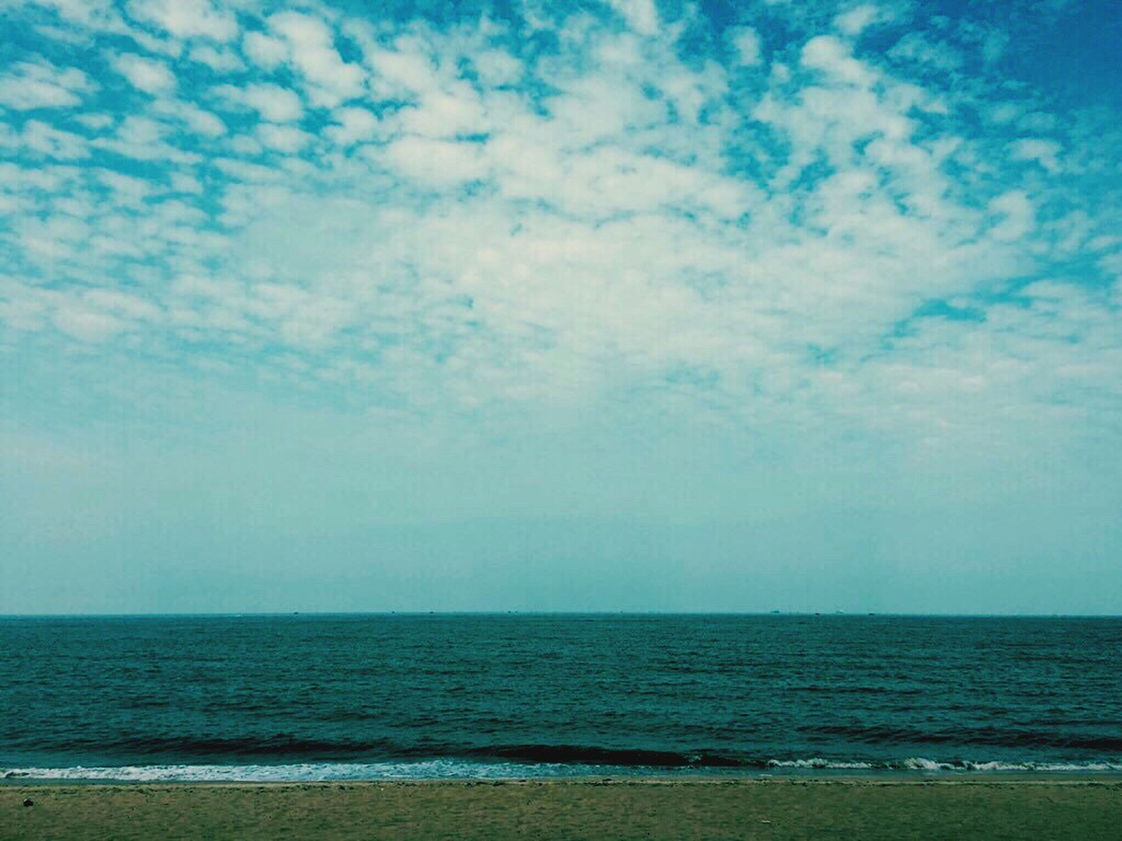 sea, horizon over water, beach, sky, water, scenics, tranquil scene, tranquility, beauty in nature, shore, blue, nature, cloud - sky, idyllic, sand, cloud, coastline, seascape, remote, cloudy