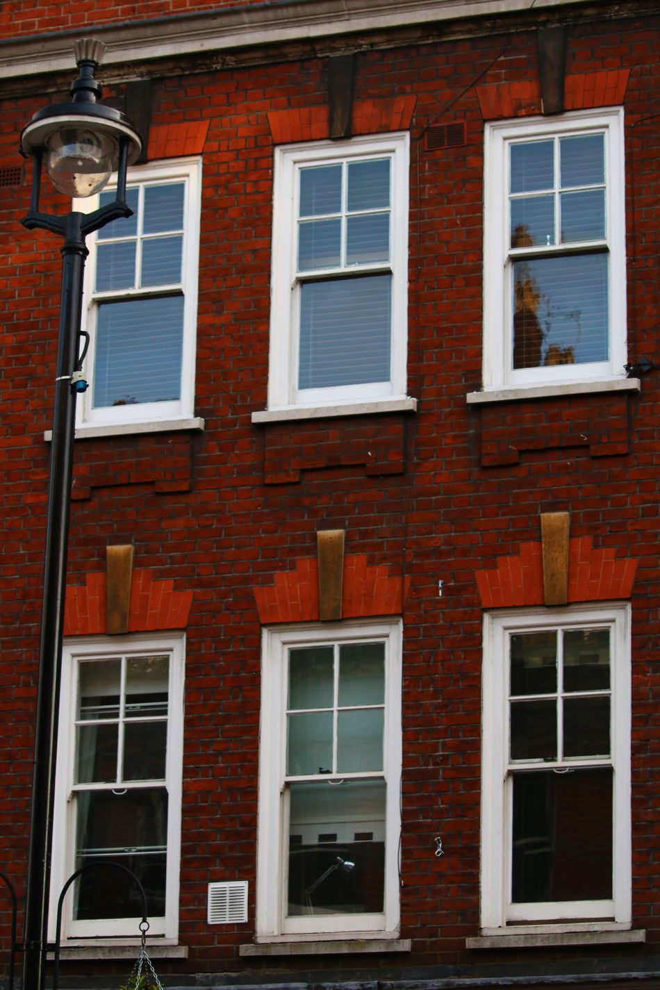 Windows Around The World Building Exterior Architecture Built Structure Residential Building Close-up Urban Exploration Geometric Shape Urban Exploring Urban Photography Close Up 3XSPUnity Eyem Best Shots Low Angle View Street Light Lamp Lamp Post Lamp Post Photography Façade Facades Brick Work
