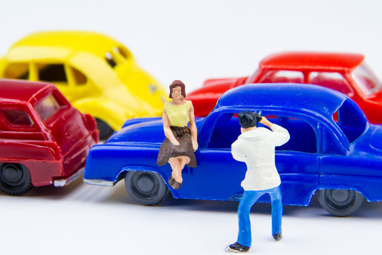 Miniature tiny toys photographer take photos woman sitting on car bonnet at the public car parking. Amateur Auto Racing Automobile Beautiful Camera Car Charming Enjoying Life Hobbyphotography Man Motorsport No People Park Photography Portrait Public Racecar Sport Sports Race Studio Shot Toy Transportation Vehicle Woman Young