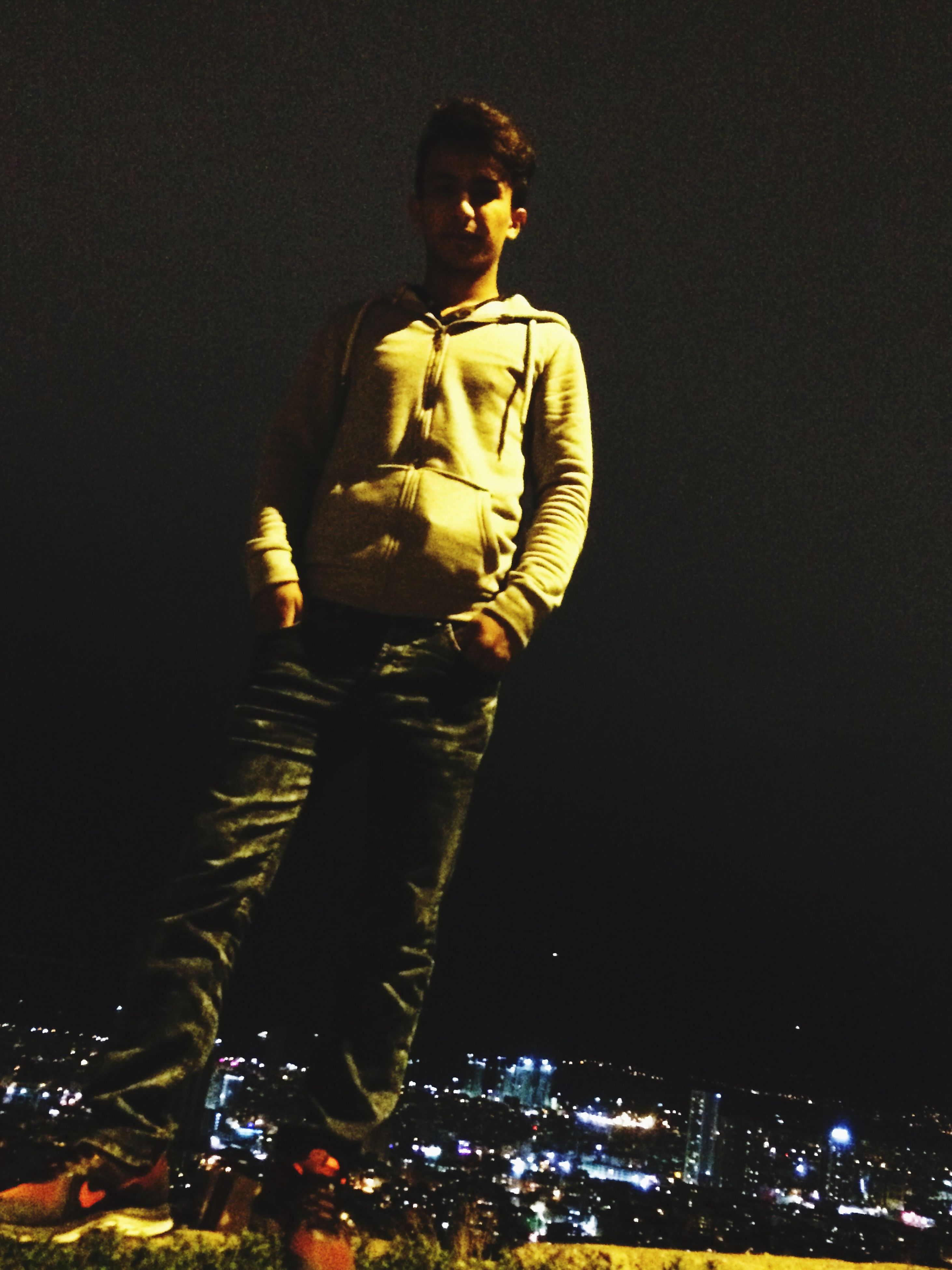 human representation, night, illuminated, sky, dark, confidence, black background, studio shot