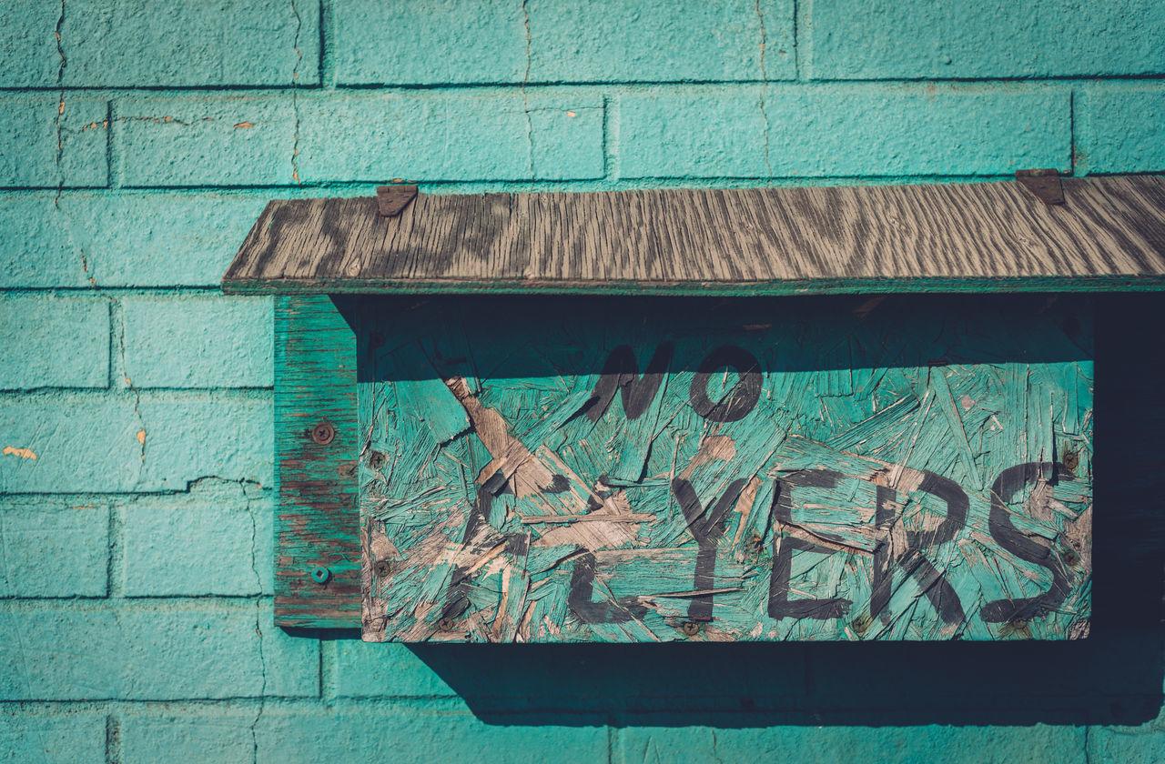 Bricks Close-up Communication Day Green Wall Mailbox No Flyers No People Outdoors Shadows