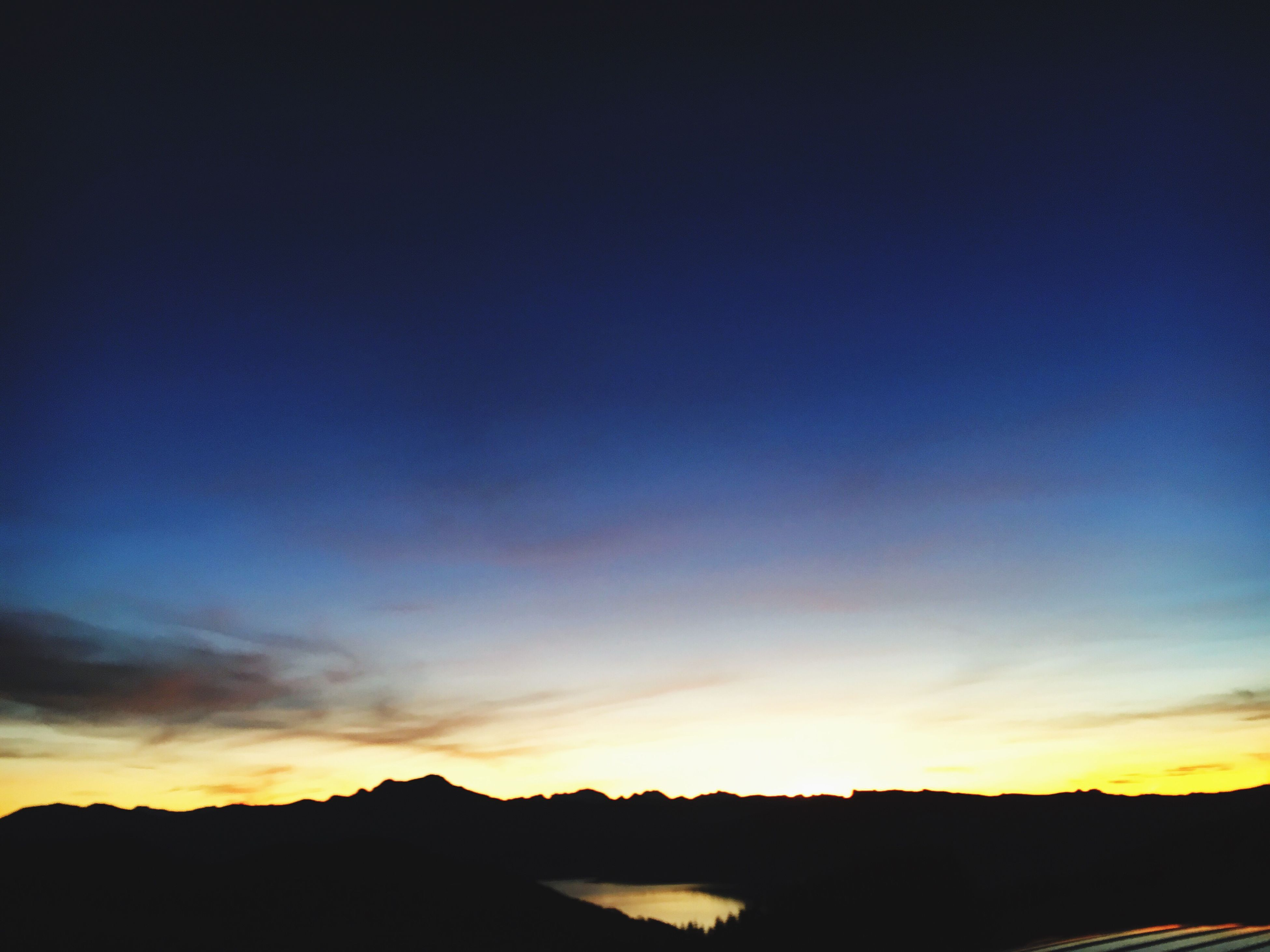 silhouette, sunset, tranquil scene, scenics, tranquility, beauty in nature, sky, nature, copy space, idyllic, landscape, dark, dusk, outline, blue, outdoors, orange color, no people, cloud, calm