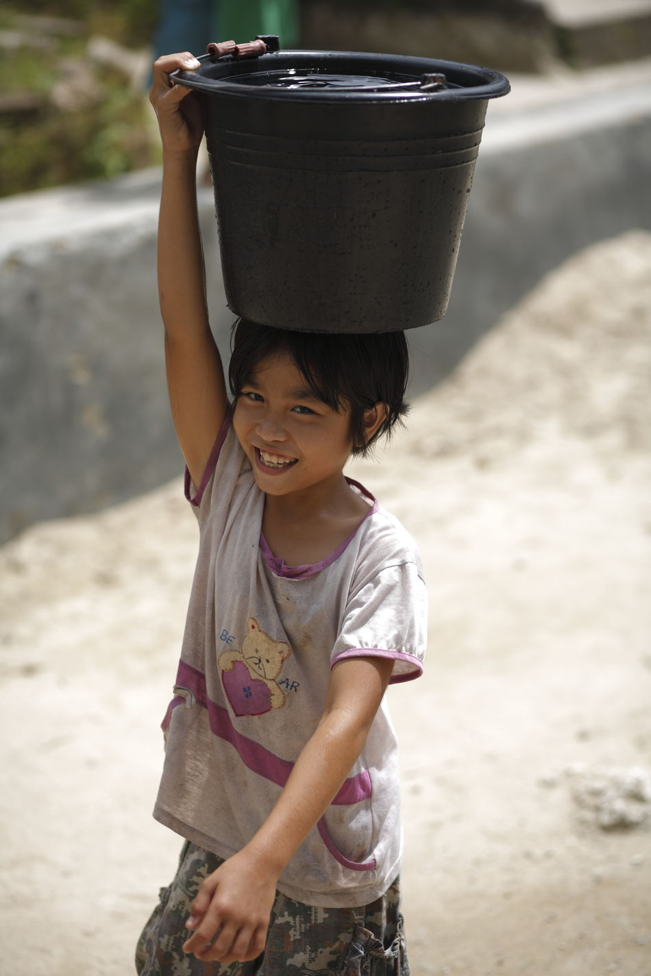 Uniqueness Real People Child Worker Carrying Water  Traditional Culture Childhood Happiness Child Smiling Nias Island INDONESIA Miles Away