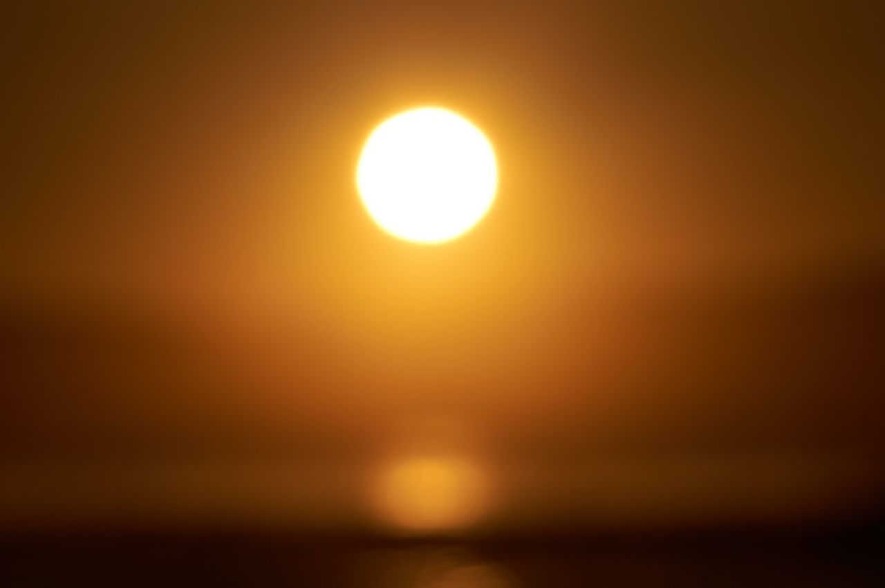 Sun Sunset Beauty In Nature Sunlight Scenics Nature Outdoors Yellow Sky Tranquil Scene No People Tranquility Water Beauty Sea Illuminated Day Astronomy Sunrise Sunlight Sunshine Sunny
