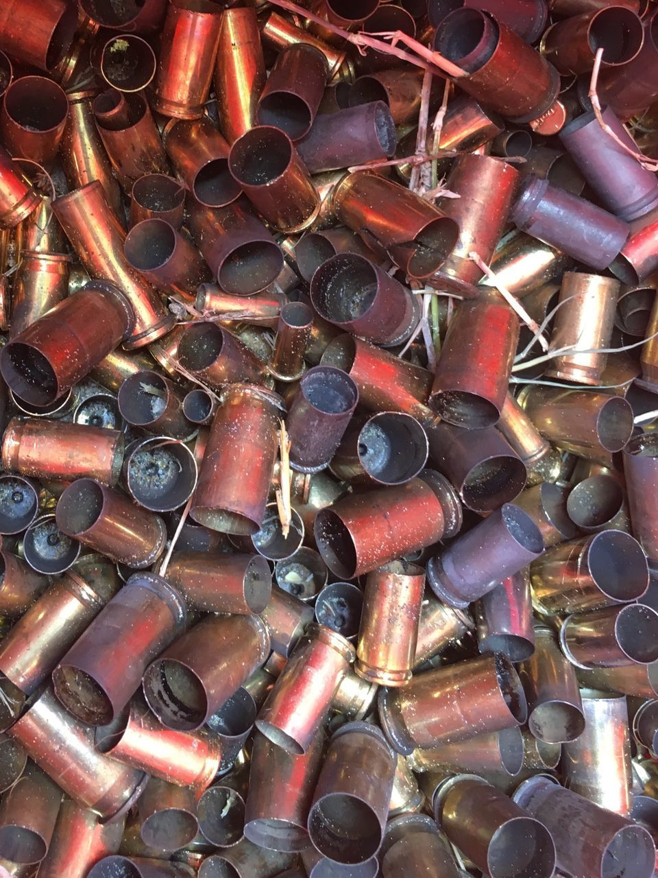 backgrounds, full frame, large group of objects, metal, no people, bullet, close-up, ammunition, indoors, day