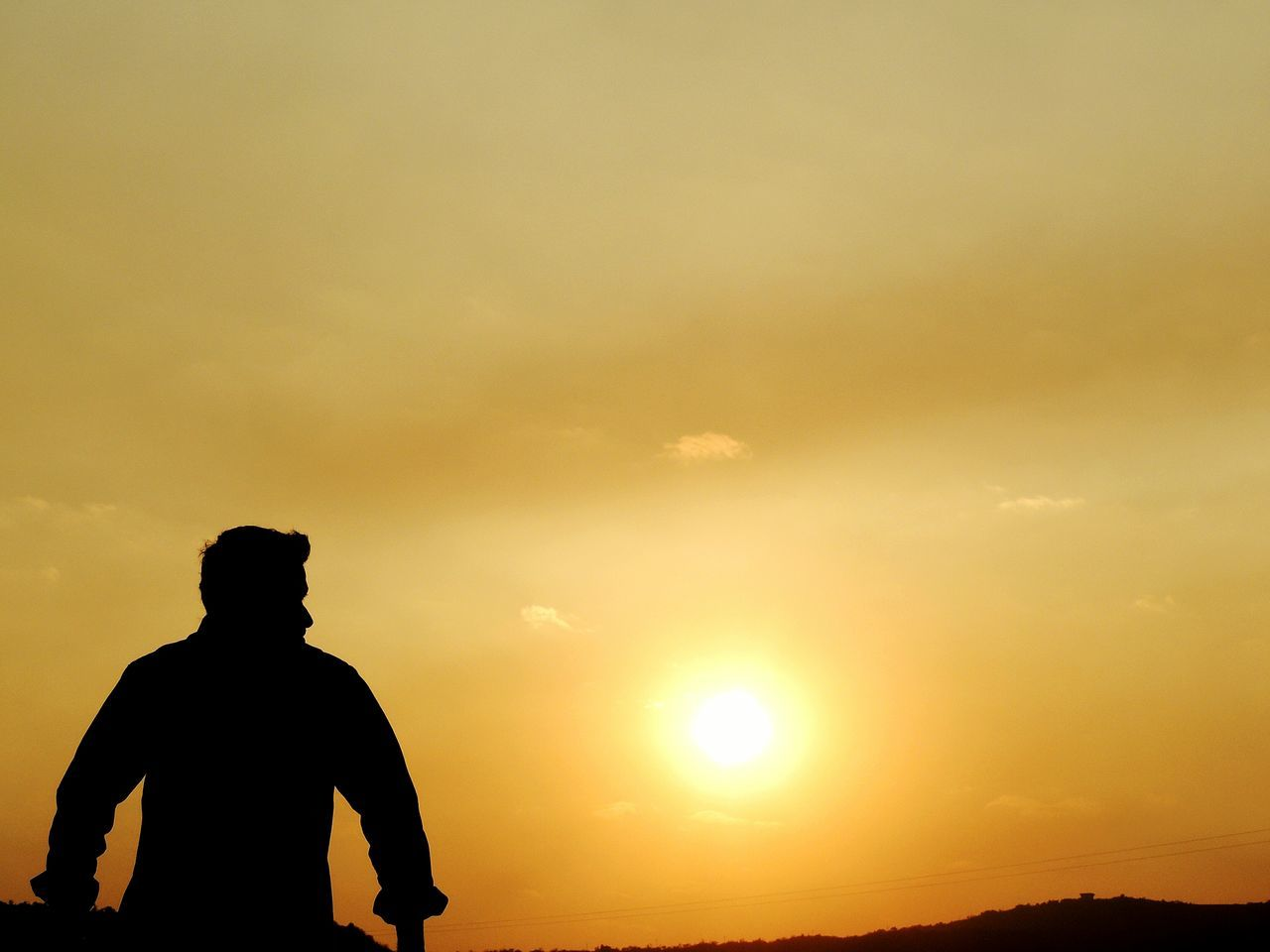 sunset, silhouette, sky, sun, real people, nature, men, outdoors, one person, leisure activity, beauty in nature, scenics, lifestyles, cloud - sky, sunlight, low angle view, sitting, one man only, day, people