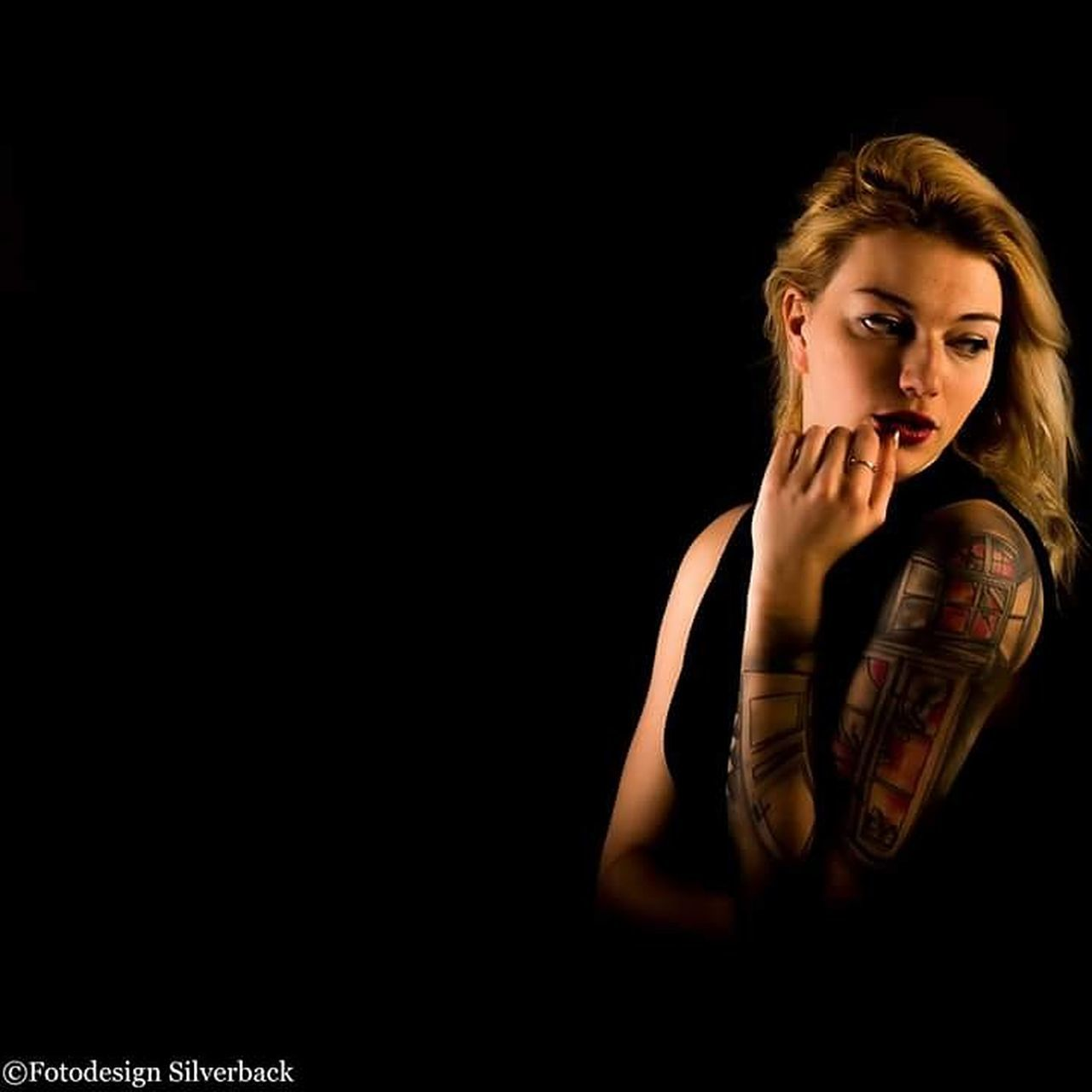 Depression - Sadness Headshot One Person Emotional Stress Shadow Dark Black Background Women One Woman Only One Young Woman Only Human Body Part Indoors  Close-up People Young Women Only Women Tattooed Tattoo Girl