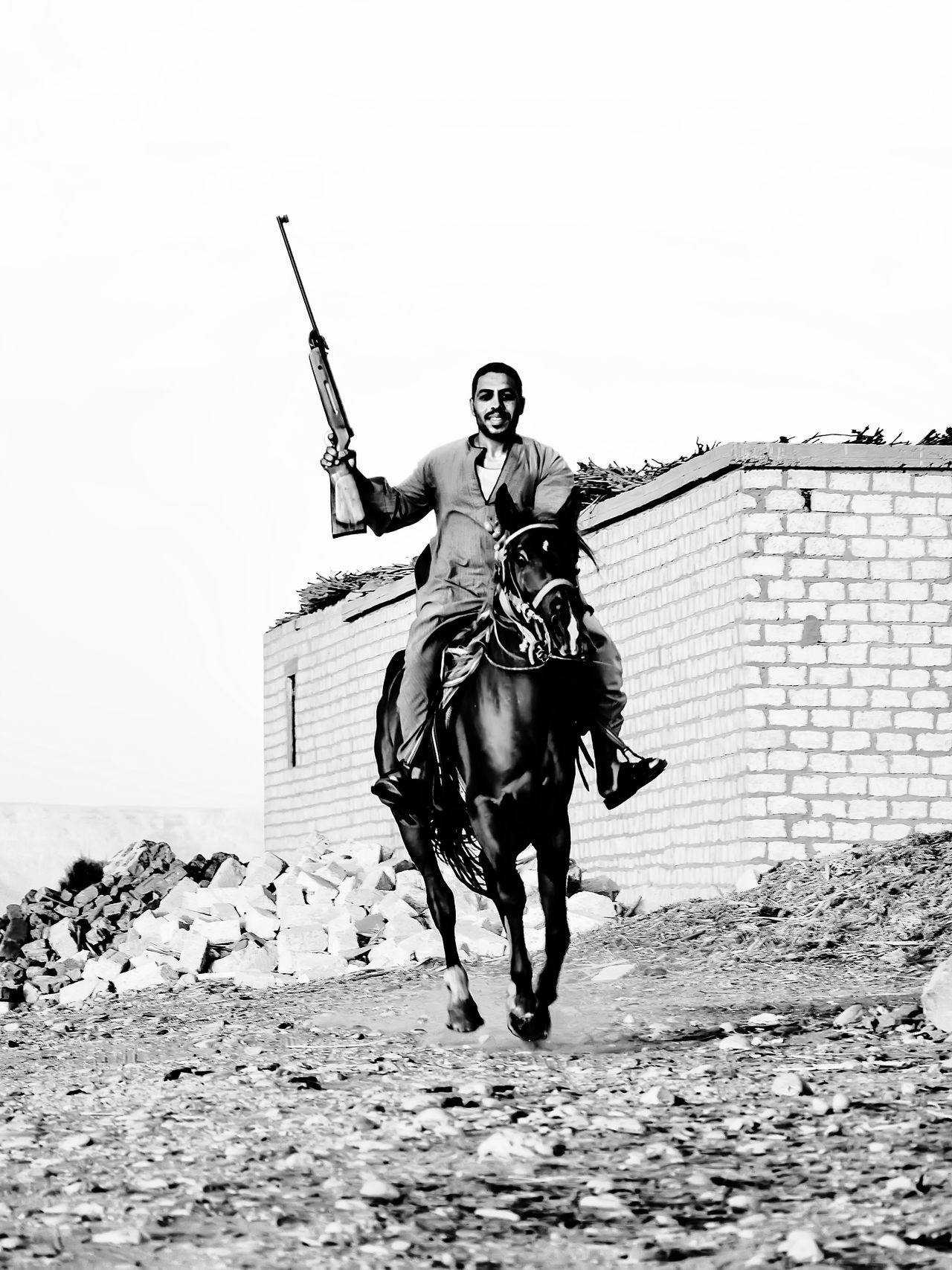 riding horses and hunting at upper egypt Black And White Blackandwhite Carefree Casual Clothing Day EyeEm Animal Lover Front View Full Length Gun Horse Hunting Long Hair Looking At Camera Outdoors People And Places Person Portrait Riding Arabian Horse Young Adult My Year My View Miles Away The Portraitist - 2017 EyeEm Awards The Photojournalist - 2017 EyeEm Awards The Street Photographer - 2017 EyeEm Awards Let's Go. Together. Sommergefühle
