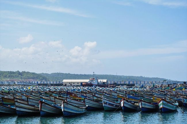 Tourism Waterfront Outdoors Nature Beauty In Nature Tranquil Scene Water Sky Boats⛵️ Boat And Water Scenics Fishing Boat Sea And Sky Seascape Fishing Boat Harbour Harbour View Harbour Life Harbourside