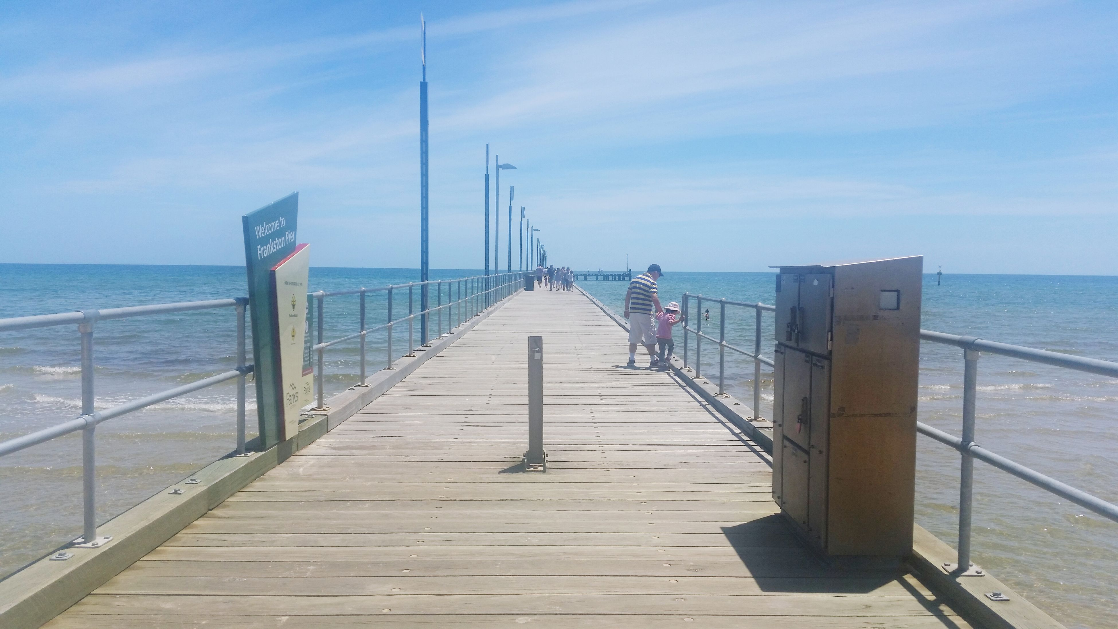 sea, water, horizon over water, pier, railing, the way forward, sky, built structure, blue, architecture, long, diminishing perspective, tranquil scene, tranquility, scenics, nature, beach, connection, jetty, wood - material