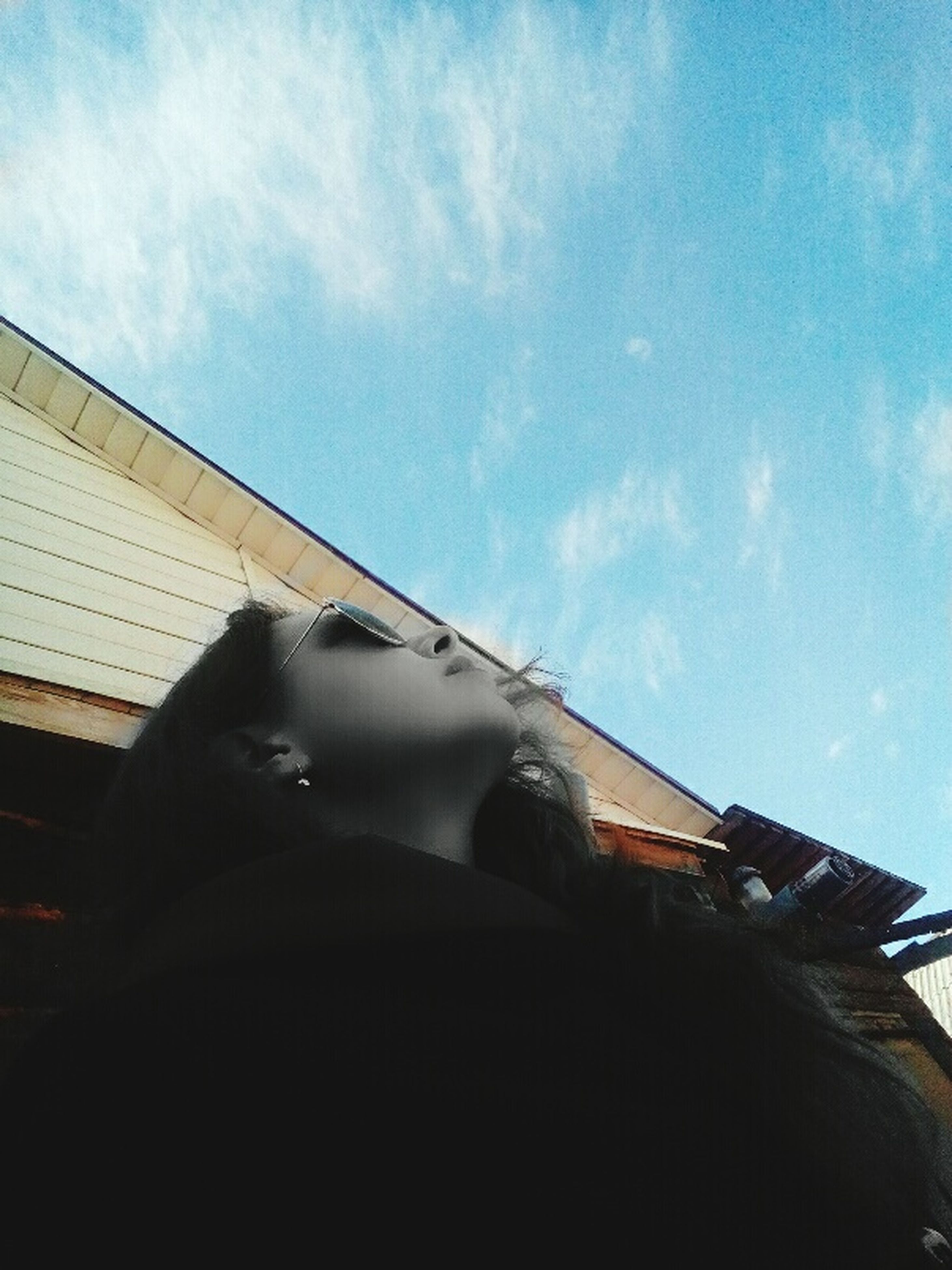 low angle view, sky, building exterior, cloud - sky, built structure, architecture, day, outdoors, headshot, one person, childhood, close-up, people