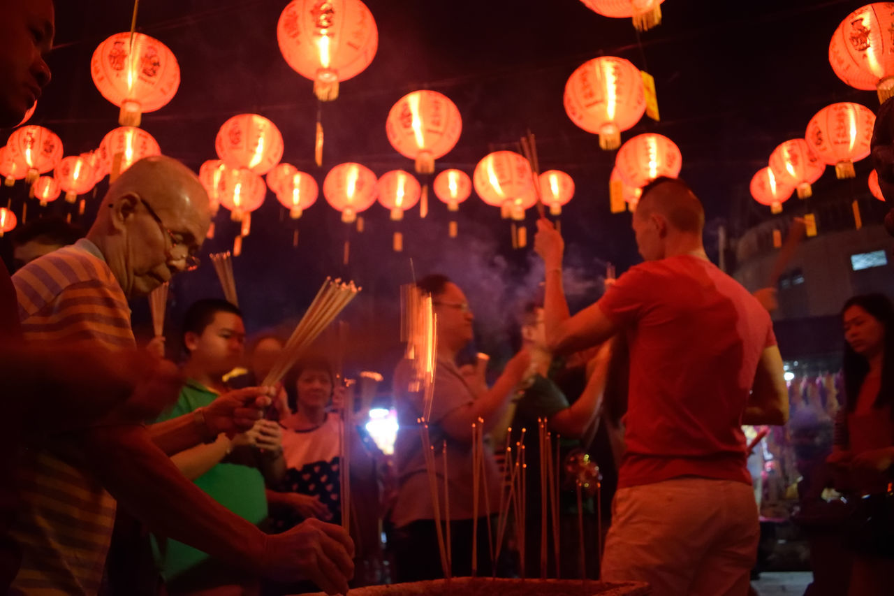 Illuminated Cultures Lantern Hanging Large Group Of People Adults Only Men Adult Indoors  People Georgetown Wanderlust Malaysia Night Tradition Chinese Lantern Chinese New Year Herritage Traditional Culture Chinese Style Chinesenewyear Burning Stick On Fire Burners