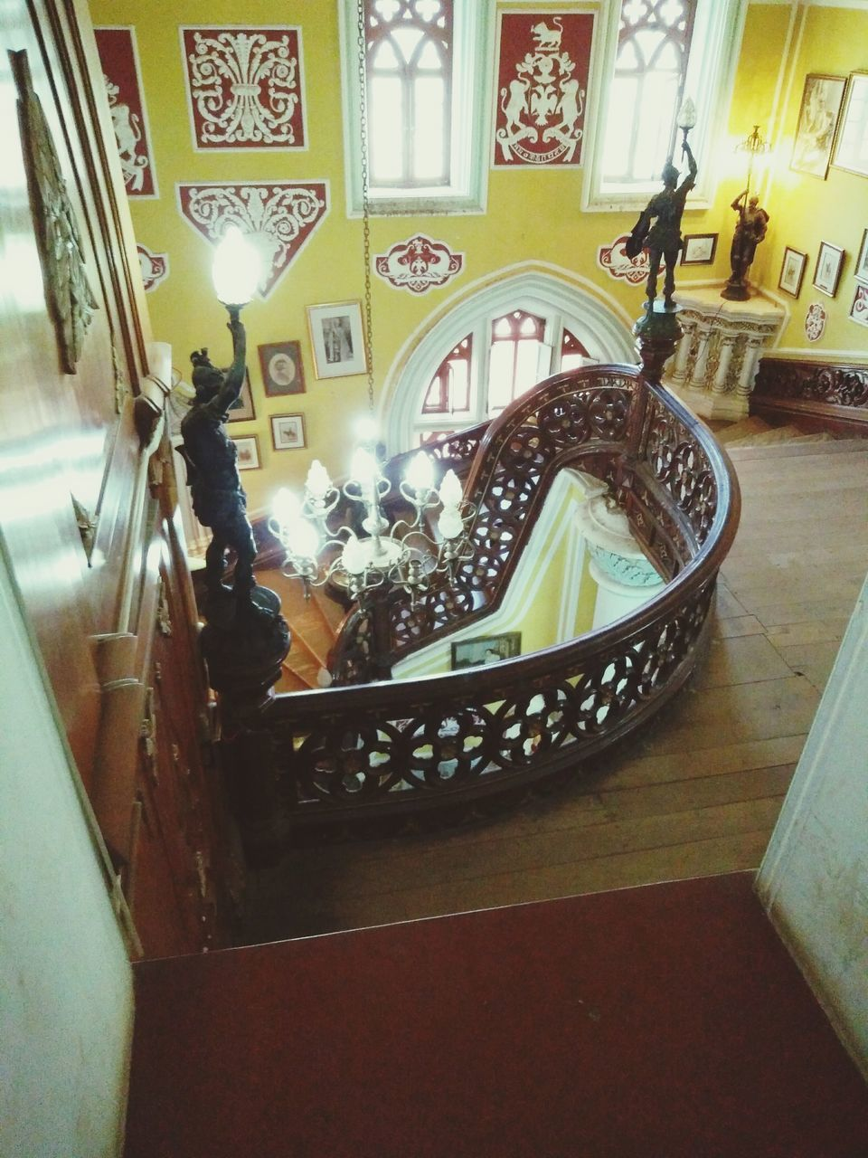 indoors, real people, staircase, full length, steps, steps and staircases, lifestyles, one person, built structure, architecture, women, day, men, people