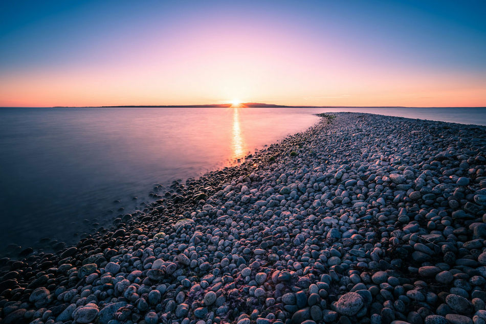 The road to the sun. Pebble Water Stone - Object Sunset Tranquil Scene Sea Scenics Beach Horizon Over Water Reflection Beauty In Nature Seascape Tranquility Sun Coastline Pebble Beach Nature Stone Shore Idyllic Beauty In Nature Sweden Water Surface Hano Ocean