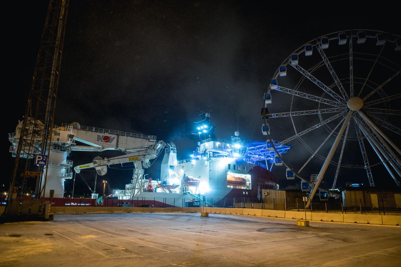 night, illuminated, built structure, arts culture and entertainment, amusement park, architecture, amusement park ride, building exterior, no people, sky, outdoors