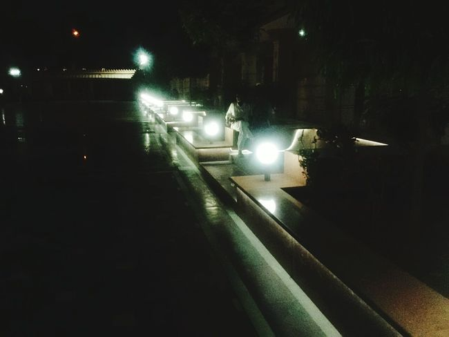 Illuminated Illuminated Night Transportation Mode Of Transport City Life Outdoors Journey Footpath The Way Forward Garden No People Green Color Diminishing Perspective Trailing Trail