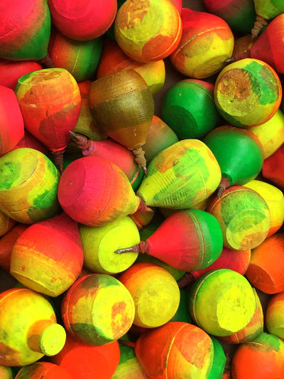 Multi Colored of Gasing a Traditional spinning top with rope Backgrounds Close-up Day Food Food And Drink Freshness Full Frame Game Gangsing Gasing INDONESIA Kids Large Group Of Objects Malay Multi Colored No People Outdoors Traditional Culture Vertical
