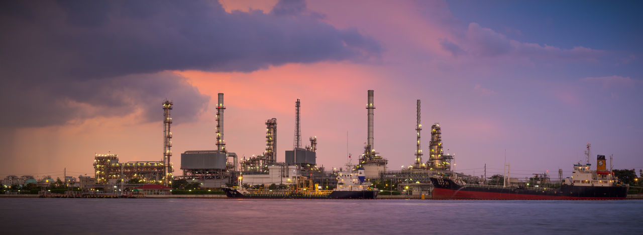Panorama shot of oil refinery industry plant, famous place in Bangkok about the beautiful oil refinery that people would like to take photo Bangkok Built Structure Cityscape Energy EyeEmNewHere Factory Fuel And Power Generation Gas Gasoline Industry Oil Oil Industry Oil Refinery Petrochemical Petrochemical Plant Petrolium Pollution Power Plant Power Station Refinery Sky Sunset Thailand Twilight The Architect - 2017 EyeEm Awards