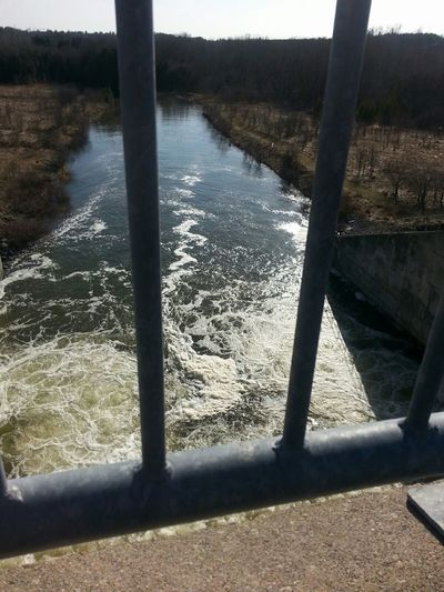 Shot From Above  Through Fence Discharge from Dam Sluice on the Speed River