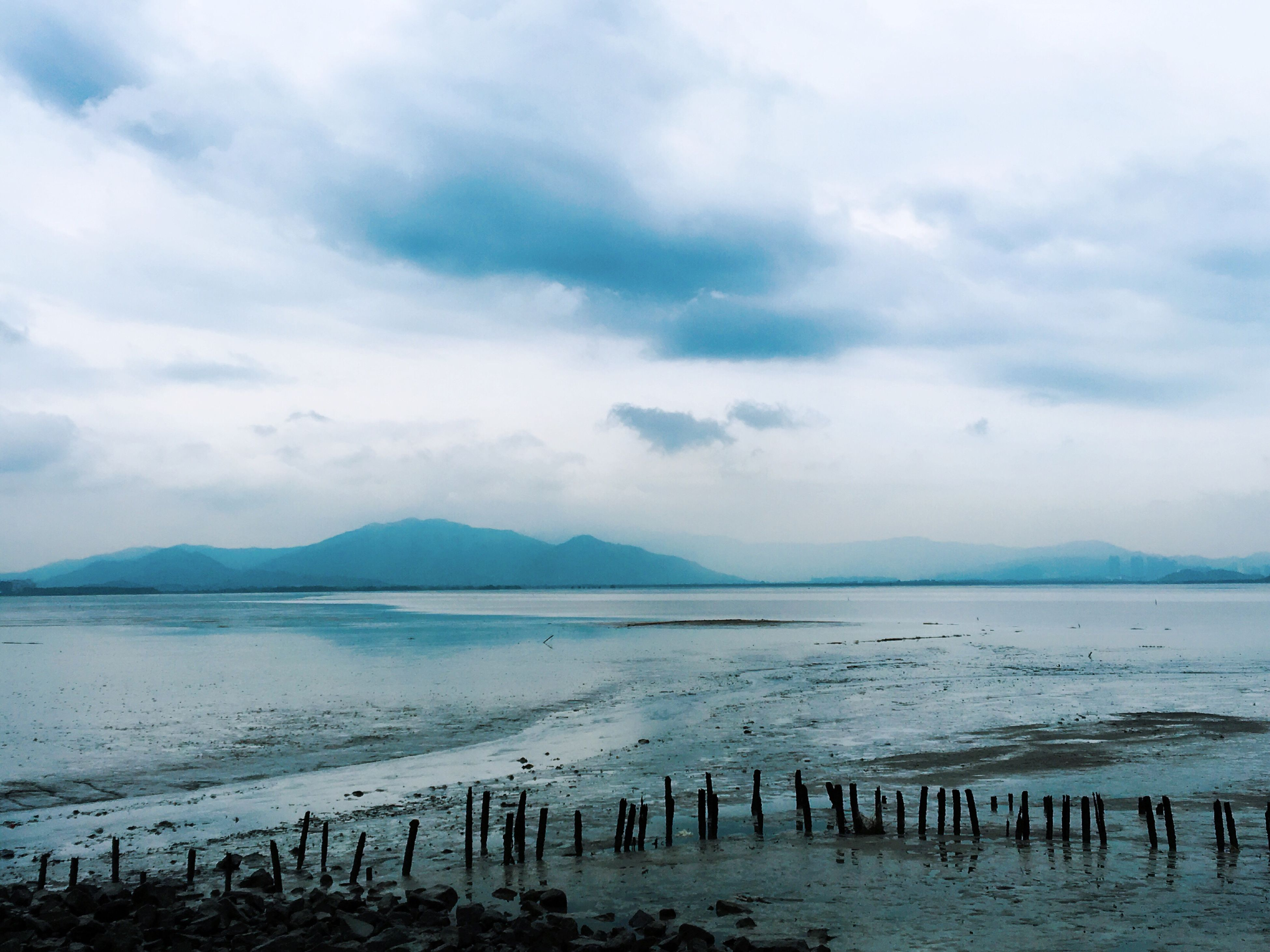 water, tranquil scene, sky, tranquility, scenics, sea, mountain, beauty in nature, cloud - sky, beach, nature, cloudy, shore, cloud, mountain range, idyllic, lake, non-urban scene, calm, outdoors