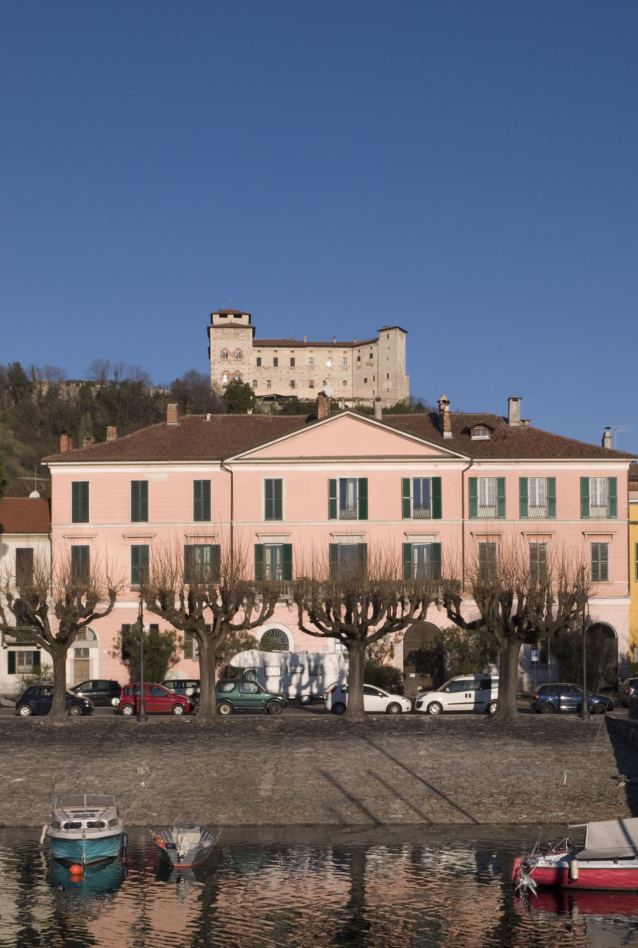 the town of Angera with Rocca Borromea on hilltop, Lake Maggiore, Lombardy, Italy Angera Architecture Building Exterior Day Europe Fortress Italy Lake Maggiore Lakeshore Lakeside Lombardy No People Rocca Rocca Borromea Town Travel Vertical