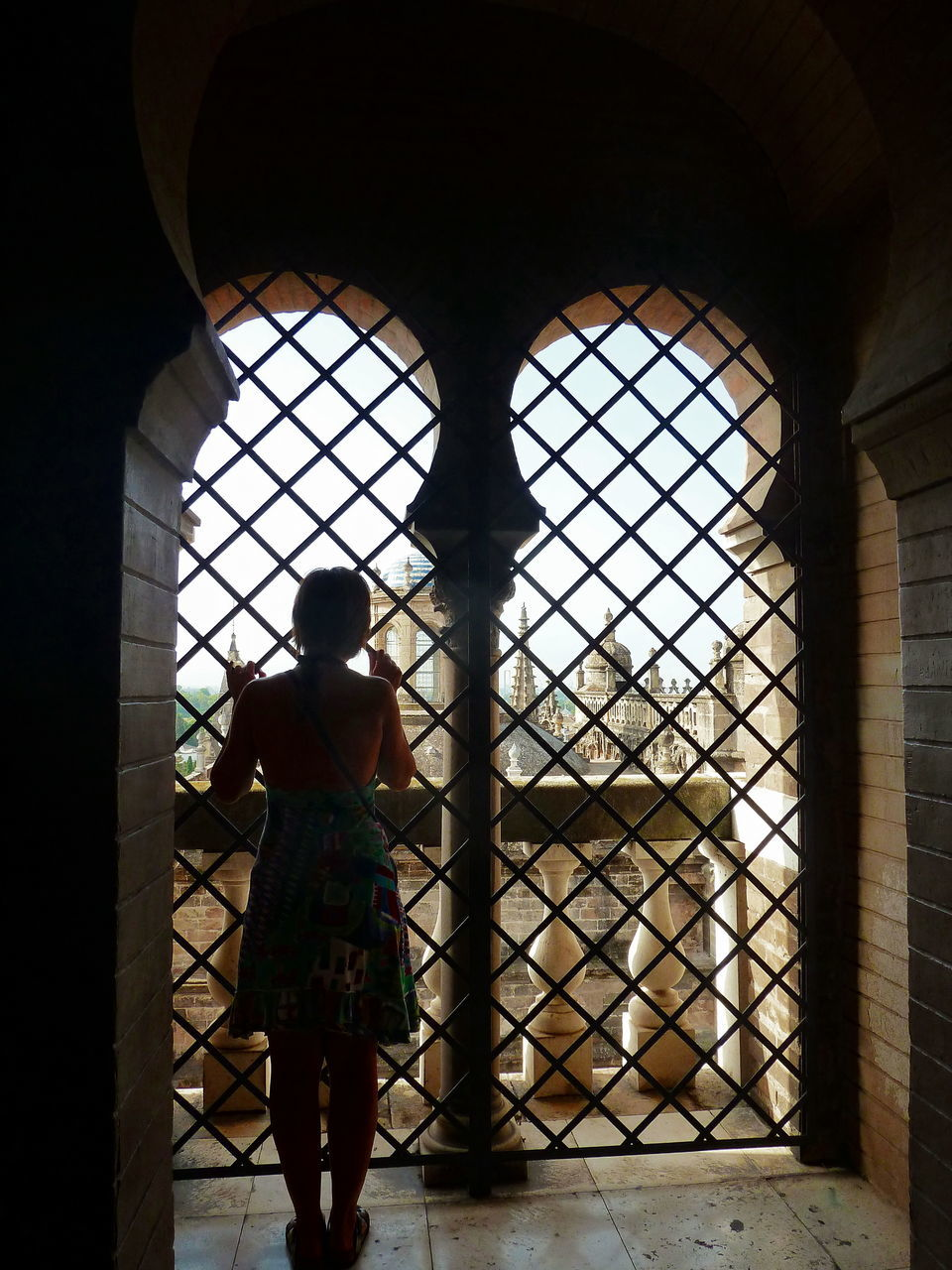 one person, rear view, one woman only, window, architecture, indoors, standing, walking, only women, day, full length, built structure, women, real people, adult, adults only, people, young adult