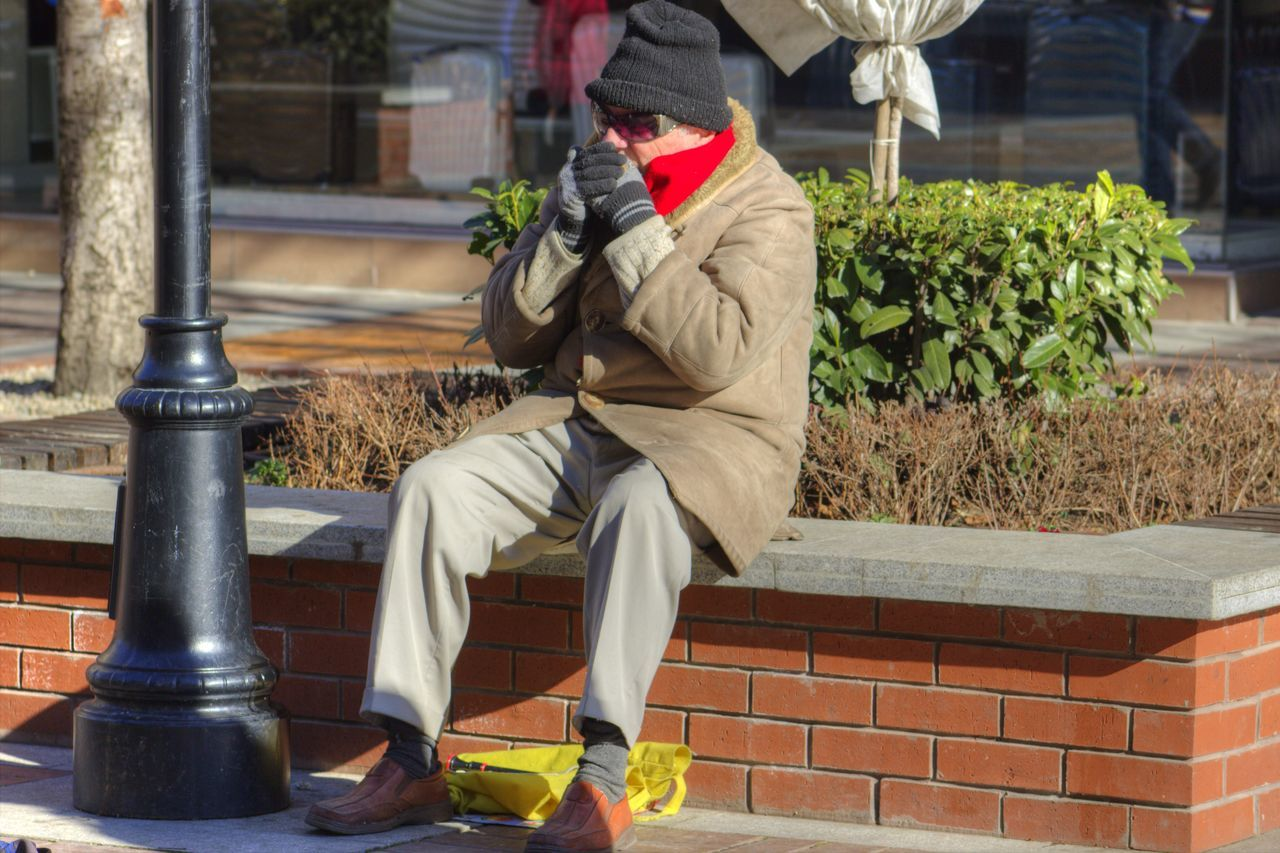 Bag Built Structure Casual Clothing City Day Focus On Foreground Incidental People Lifestyles Men Old Man Outdoors Sitting Man Street Street Musician Sunglasses Sunny And Cold Traditional Clothing The Street Photographer - 2016 EyeEm Awards Up Close Street Photography