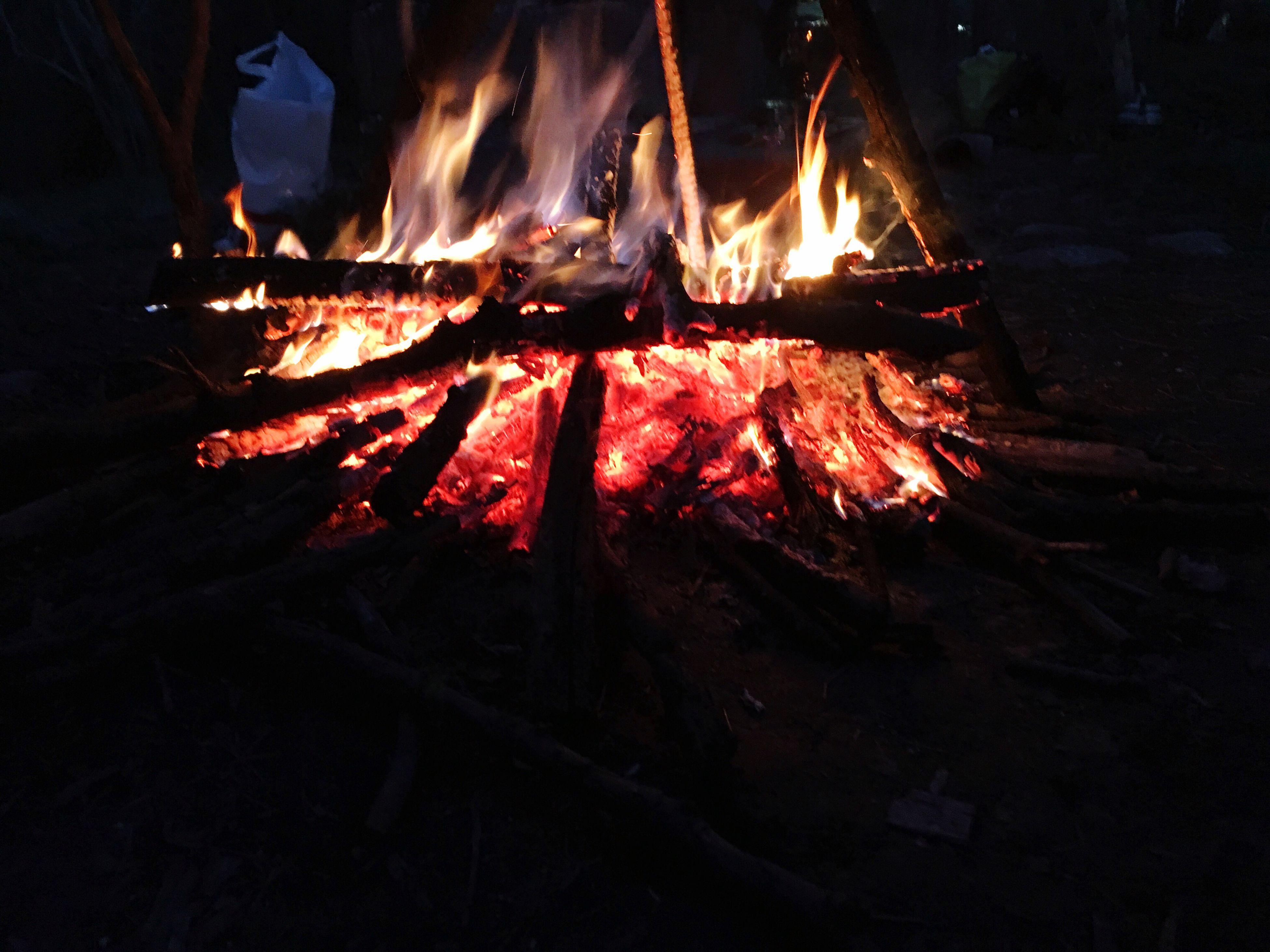 night, fire - natural phenomenon, burning, flame, heat - temperature, glowing, illuminated, bonfire, fire, firewood, motion, long exposure, dark, wood - material, campfire, close-up, outdoors, orange color, no people, light - natural phenomenon