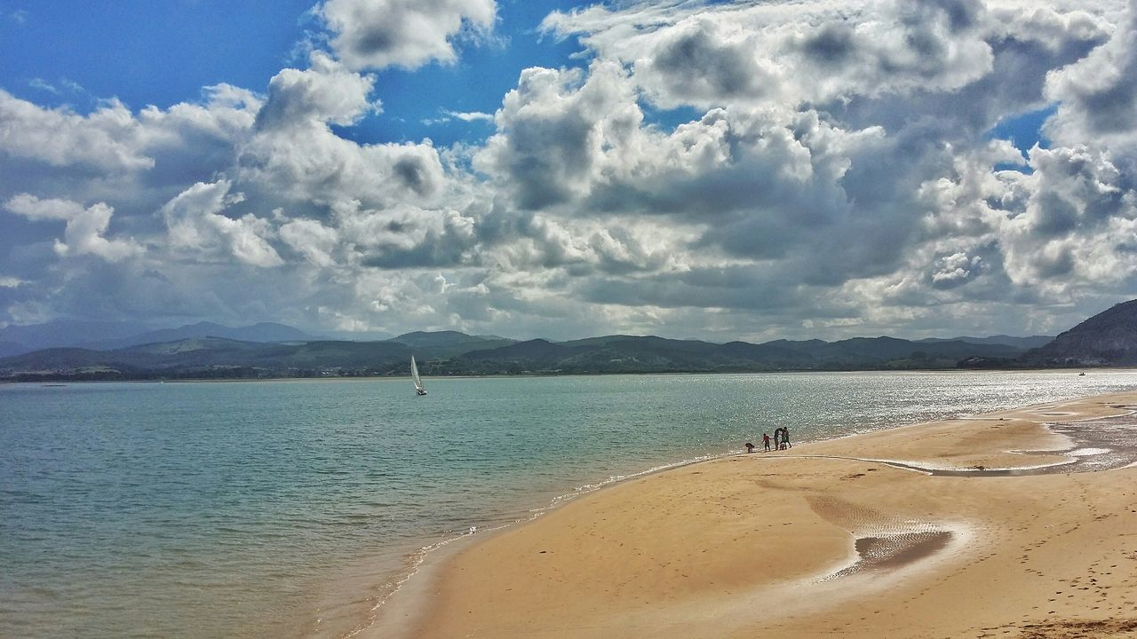 sand, beach, cloud - sky, sky, sea, water, nature, beauty in nature, scenics, tranquility, tranquil scene, day, mountain, outdoors, no people, travel destinations, vacations