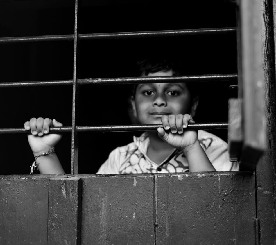 The Photojournalist - 2017 EyeEm Awards A noy punished by his mother for his mischef Punishment Prisoner Trapped Metal One Person Children Only