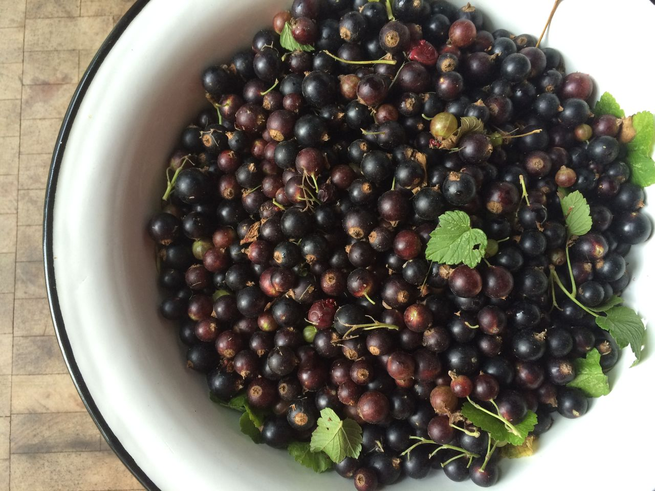 High Angle View Of Black Currants In Bowl On Table