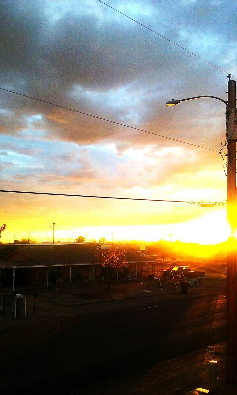 sunset, sky, cloud - sky, silhouette, orange color, nature, outdoors, beauty in nature, sun, no people, scenics, landscape, telephone line, day