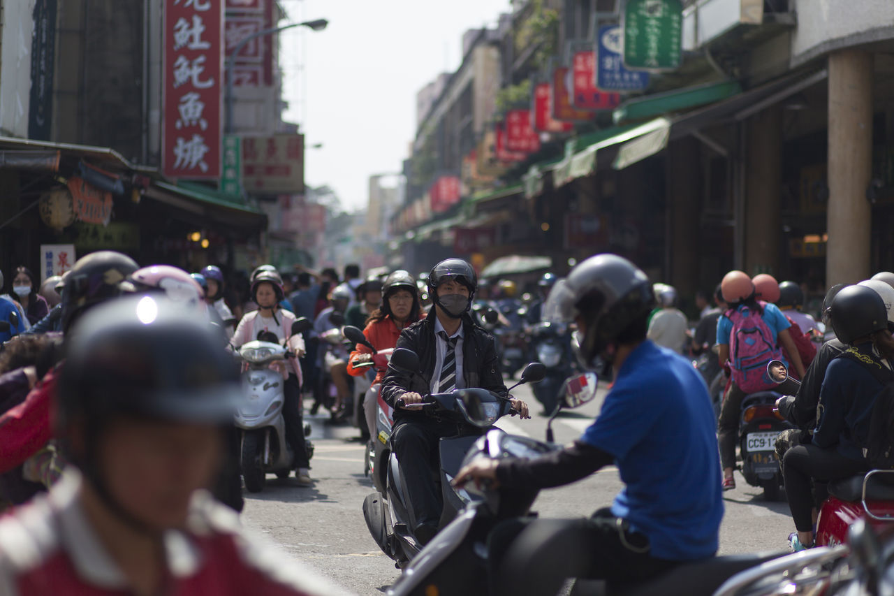Busy street full with motorcyclist in Tainan city, Taiwan. ASIA Chinese City Cycling Cyclist Daily Life Editorial  Helmet Large Group Of People Lifestyle Motorcycle Outdoors People Real People Tainan Taiwan Transportation