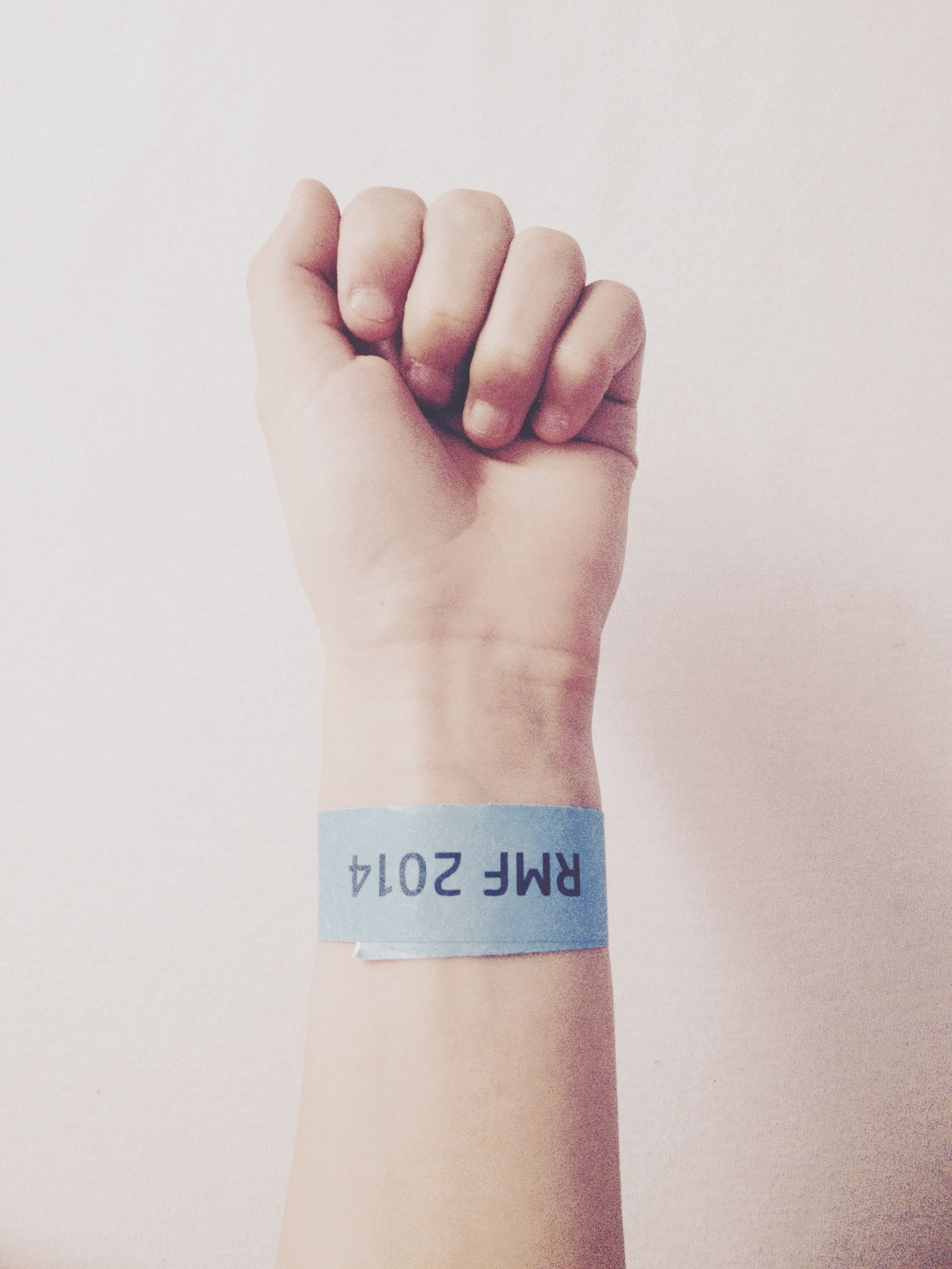 person, part of, indoors, human finger, cropped, white background, studio shot, close-up, communication, text, holding, western script, wall - building feature, copy space, lifestyles, personal perspective